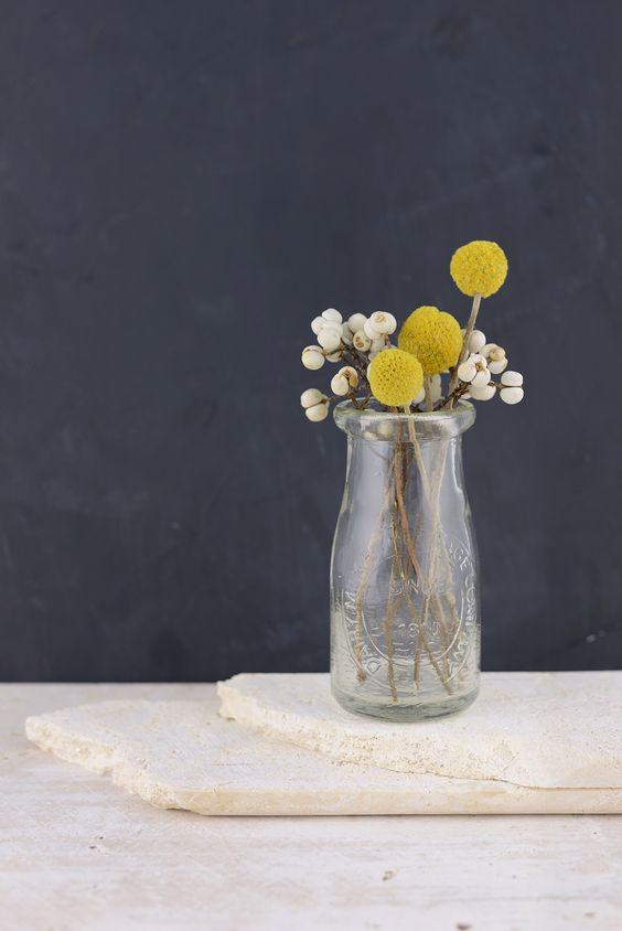 Flowers           - Adding fresh flowers to your home helps you to create layers for a warm and inviting space. This simple milk bottle vase is great to use inside or outside! Fresh Crespedia flowers are great for adding color to any space and they will last forever so you can enjoy them all summer long!