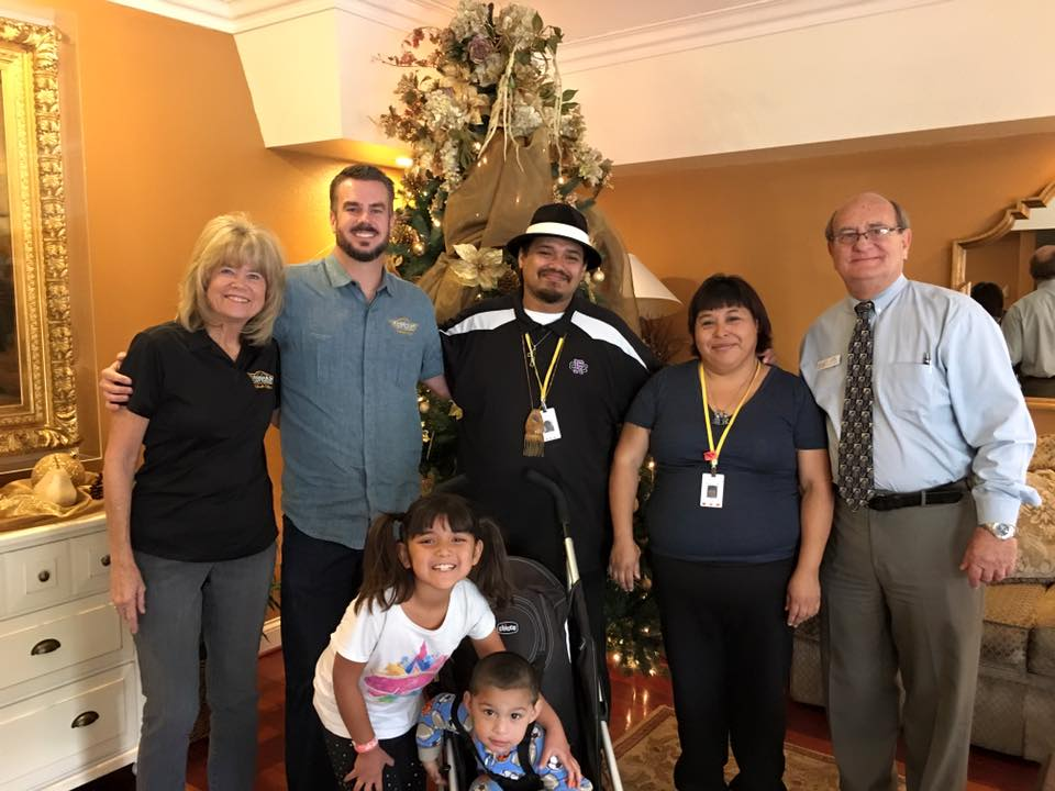 Owner and President, Ben Cook stands with his mother and a family living in the Ronald McDonald House in Loma Linda.