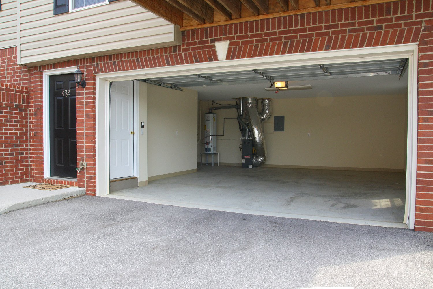 Lincoln, Windsor and Chatsworth models include an attached 2-car garage, with extra storage beneath the stairs.