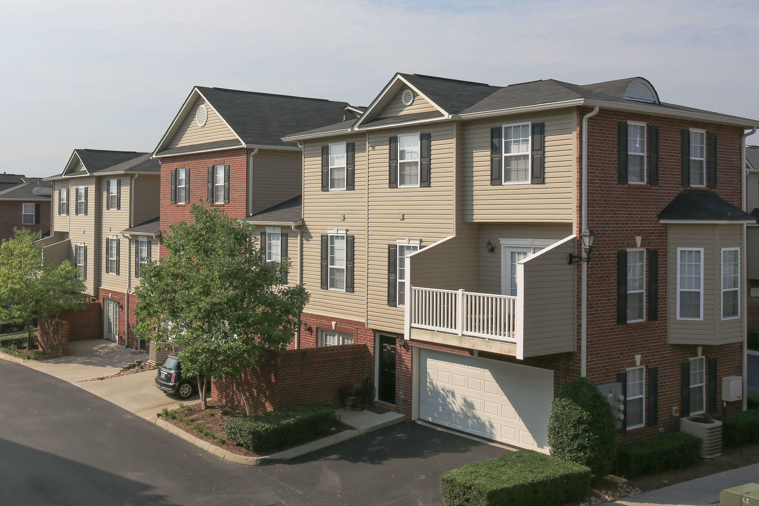 Luxury townhomes and apartments for rent in Knoxville, TN, with attached garages and hardwood-style floors.