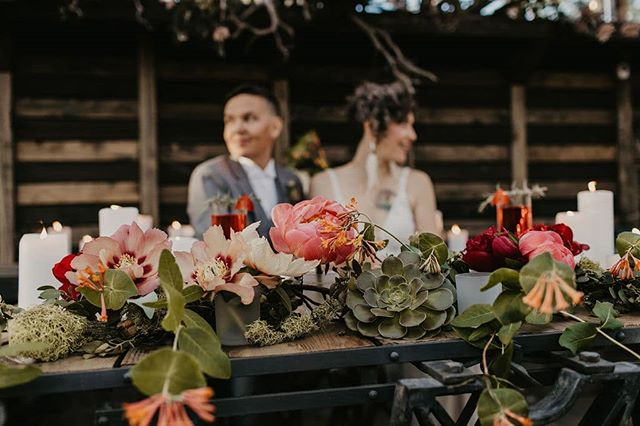 I love a good sweetheart table! Especially when the couple gets to canoodle behind an array of foraged florals from the florists own garden!  Photographer: @juliadukephoto  Florals/Venue: @chasing_flowers_bend  Dress: @thebespokebride @wilderlybride  Makeup: @wrenandwild  Earrings: @featherdivine  Dessert: @foxtailbakeshop  Invitations, Design and Paper Goods: @thinkmakedesign  Couple/Models: @court_c.note @ameswright7 . . . . . . #bendwedding#weddingdesign#weddingstylist#foragedflorals#greenhousewedding#loveislove#pride#oregonwedding#centraloregonwedding#oregonweddingcoordinator#bendweddingplanning#bendweddingplanner#sweethearttable#weddingflorals