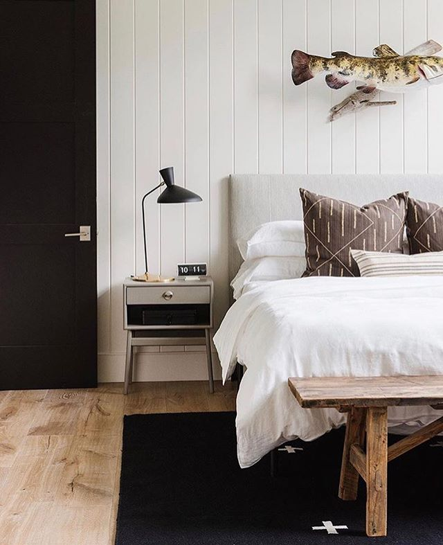 There's something about a good, soft rustic floor. Love this bedroom designed by @studiomcgee | Get this hardwood look for just $2.99 sq ft. Give us a call today to get a FREE measurement ——  📞 801-563-8226