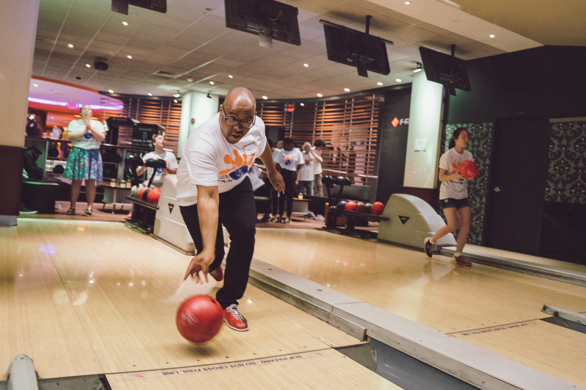 A bowler and fundraiser for All Starts Project participates in their annual Bowl-A-Thon. Photo by Daniel Lee.