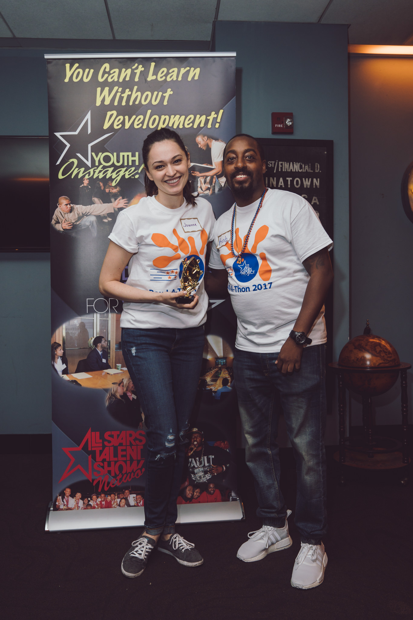 Celebrating high fundraising numbers at All Stars Project's annual Bowl-A-Thon fundraising event. Photo by Daniel Lee.