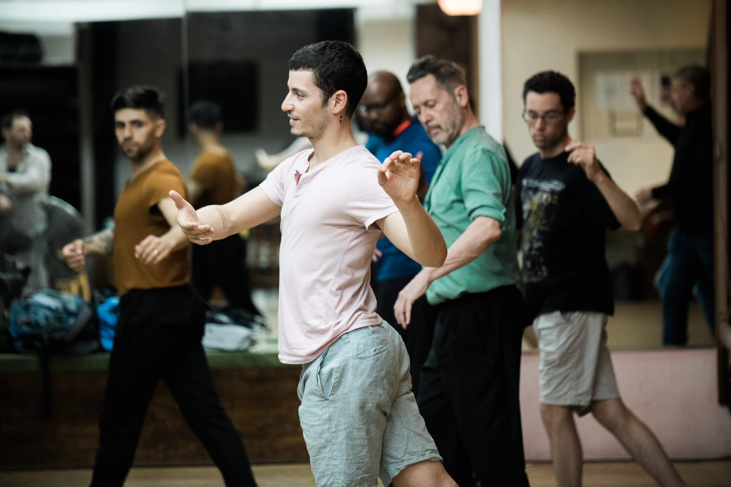 Alonso leads members of  Queer Tango NYC  through some intermediate steps.
