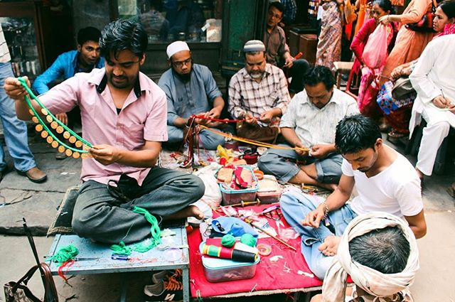 When I traveled to Nepal in 2016, I had been running my (now dormant) jewelry company, @iarabeadwork, for nearly two years. So when I stumbled upon Kathmandu's bead market, I felt an intense calm in the midst of the city's relentless chaos—soothed by the riot of colors, the familiar feeling of rolling a bead between my thumb and index finger, the bold swirls of incense. After wandering the entirety of the market, I returned to the first shop I had seen and painstakingly selected three bolts of red beads—burgundy for strength, fuchsia for awareness, and candy apple red for passion—and asked the men pictured here to spin them into a necklace. Two weeks later, as I crossed the world's highest navigable pass by myself, I took the necklace out of my pack and put it on. It was an act of arguably excessive symbolism, the type a poet might write about but never actually do, and it was perfect.