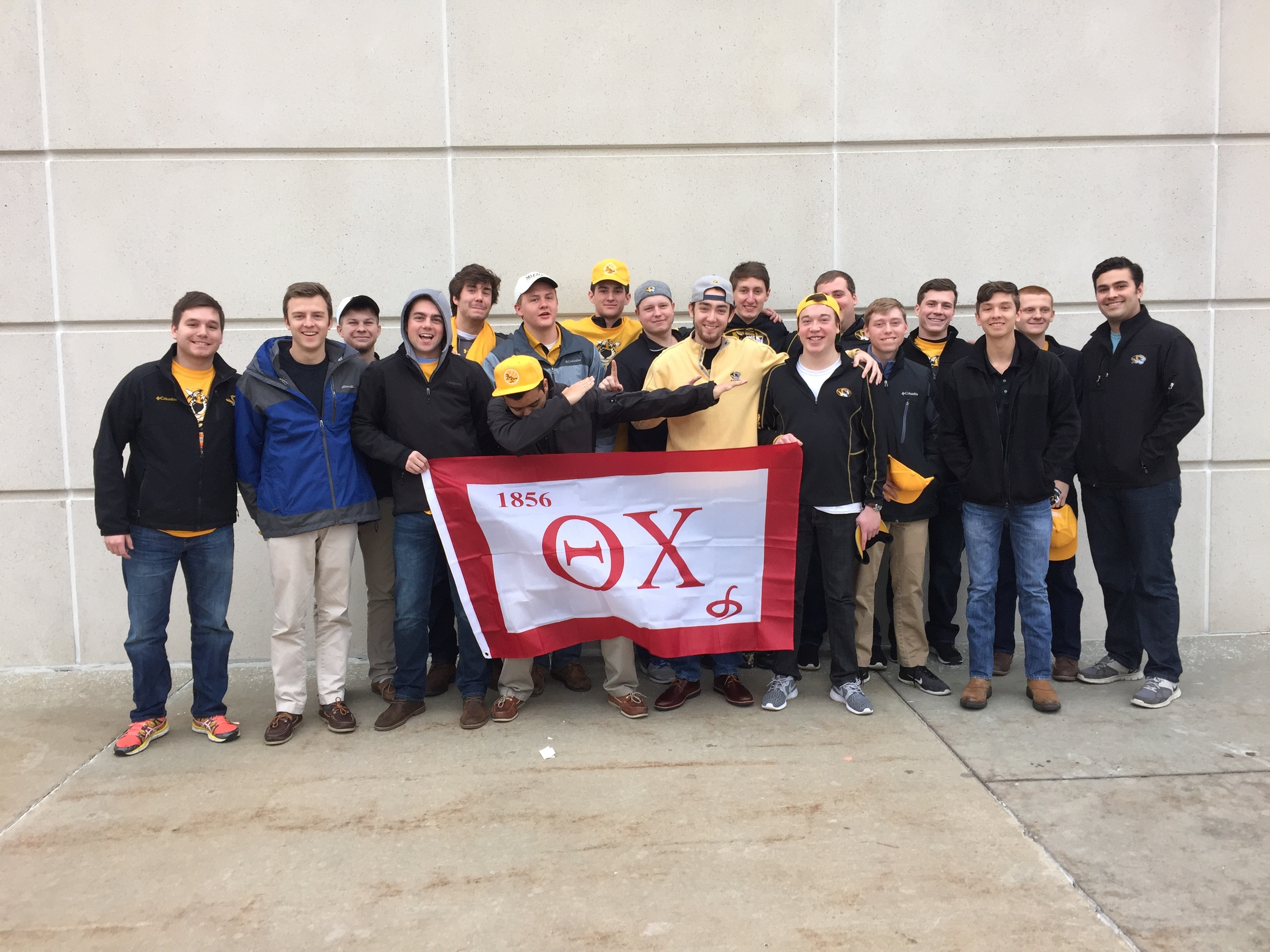 18 of the nearly 50 Theta Chi's in attendance for The Rally For Rhyan Game