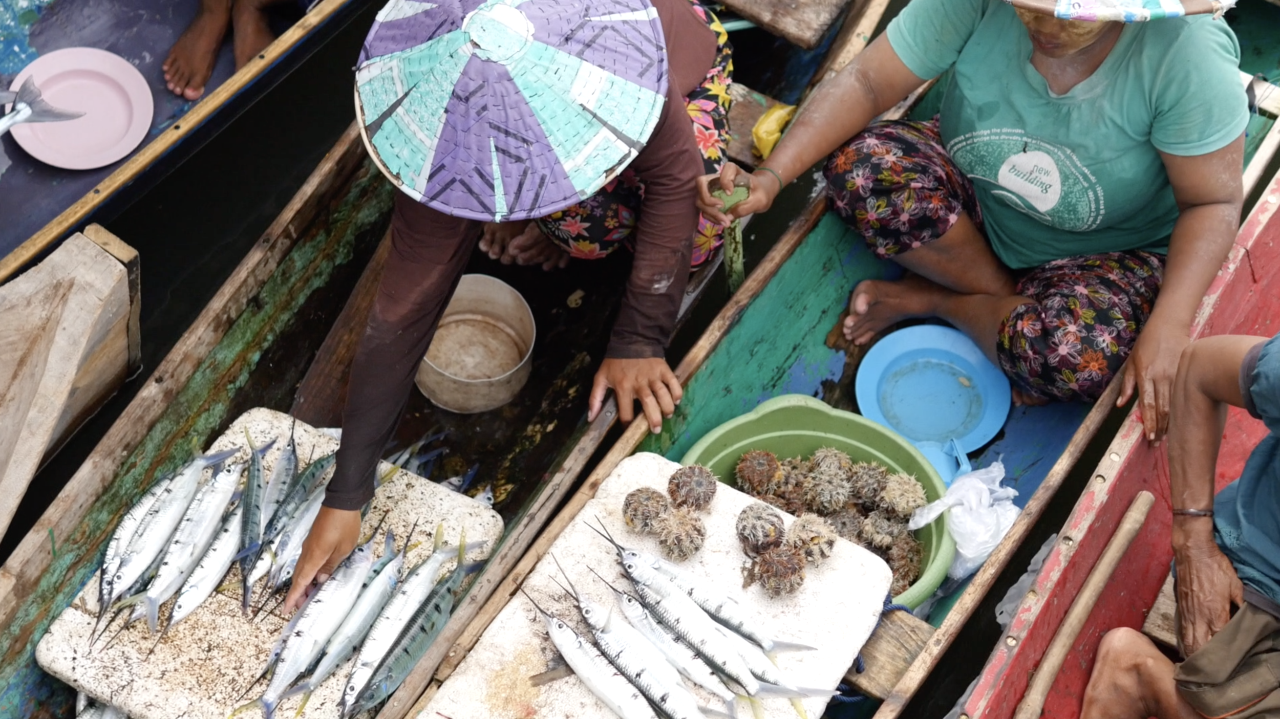 Women from Sampela selling fish at the market on the nearby island. The women pull up in their boats and never have to go on land.