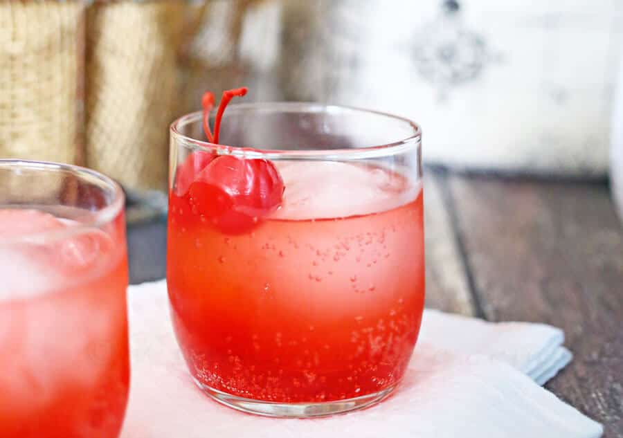 Cherry Bomb Mocktail - INGREDIENTS PER GLASSLemon Lime SodaGrenadineLimeMaraschino CherriesDIRECTIONSGrab your pitcher and combine the soda, grenadine and lime juice. Give it a big stir to mix it up!Pour over the rocks or ice ball in law ball glass then garnish with cherries.