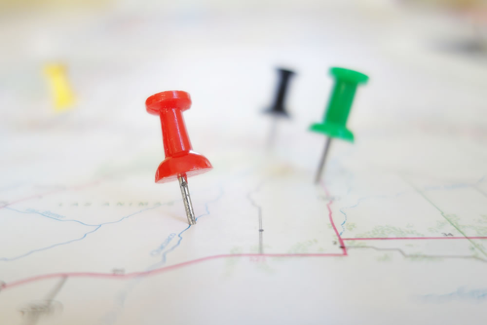 yellow-red-green-black-pushpins-in-a-map.jpg