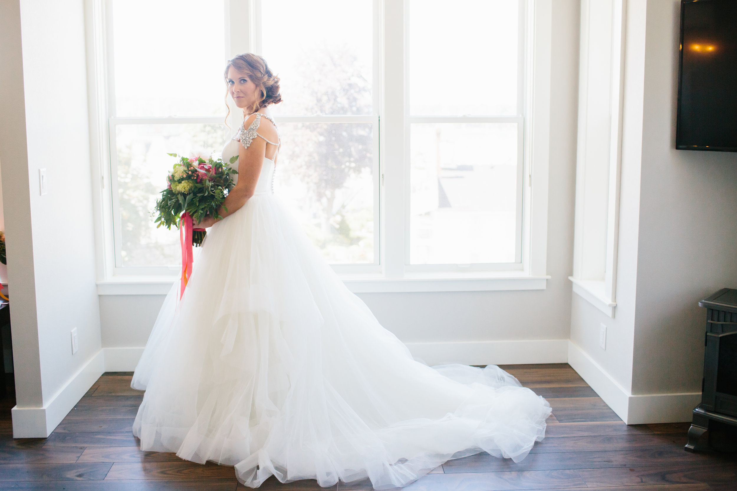 Photo by Sara Parsons. Wedding Dress from I Do Bridal