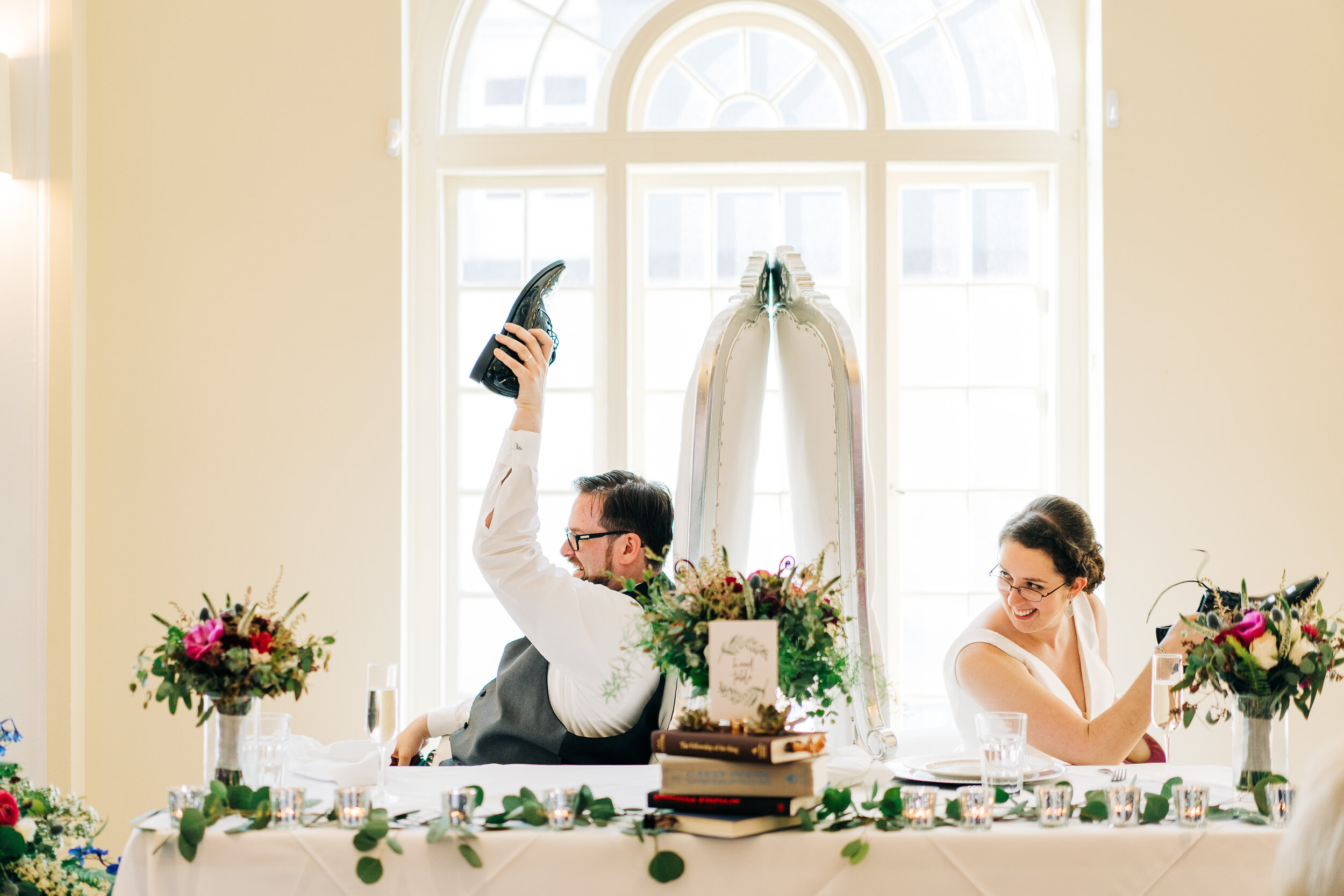 Photo by      Captus Photography        A way to keep your guests entertained with dinner: trivia about the couple and our favorite: The Shoe Game.