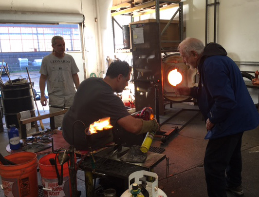 """Wayne working on the Night in Tunisia """"genie"""" bottle with Guido Gerlitz and Mark at Effetto Glassworks."""
