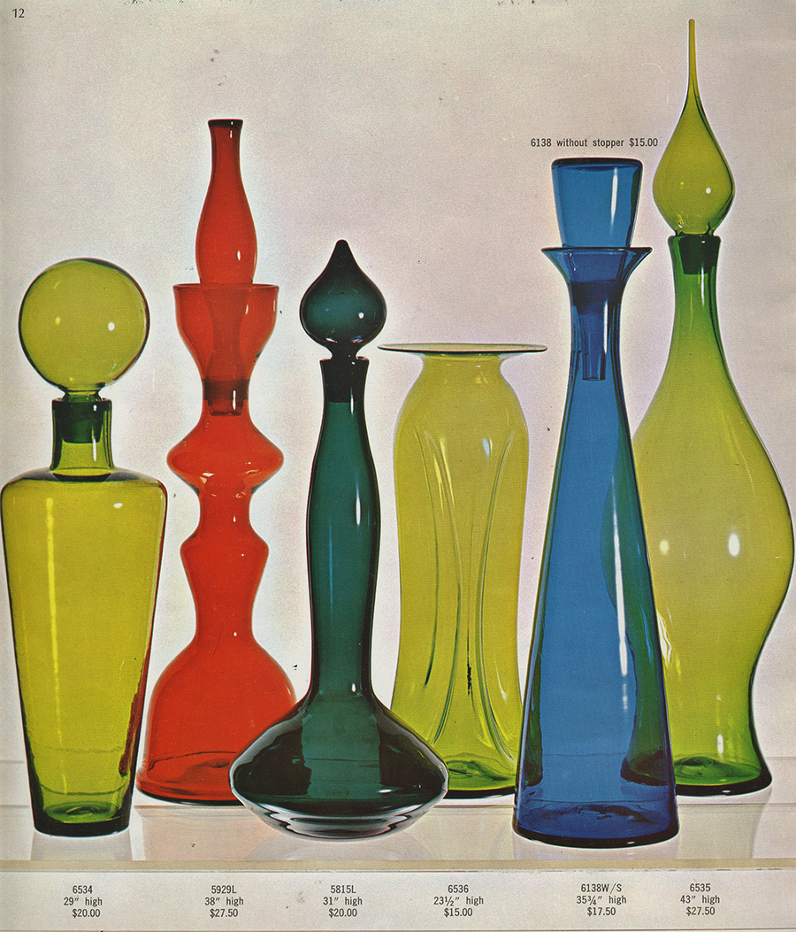 """Photo from Blenko Glass Company's 1965 catalog, showing three of my large scale, nonfunctional architectural pieces. The second from the left in tangerine is my 5929 """"Chess Piece,"""" 38"""" high, designed in 1959. The charcoal gray piece 5815L is a design I created in 1958, and the cobalt blue is another of my architectural pieces issued in 1961. In the numbering system that I pioneered at Blenko the first two numbers are the year and the next number indicates the sequence in which I developed the design."""