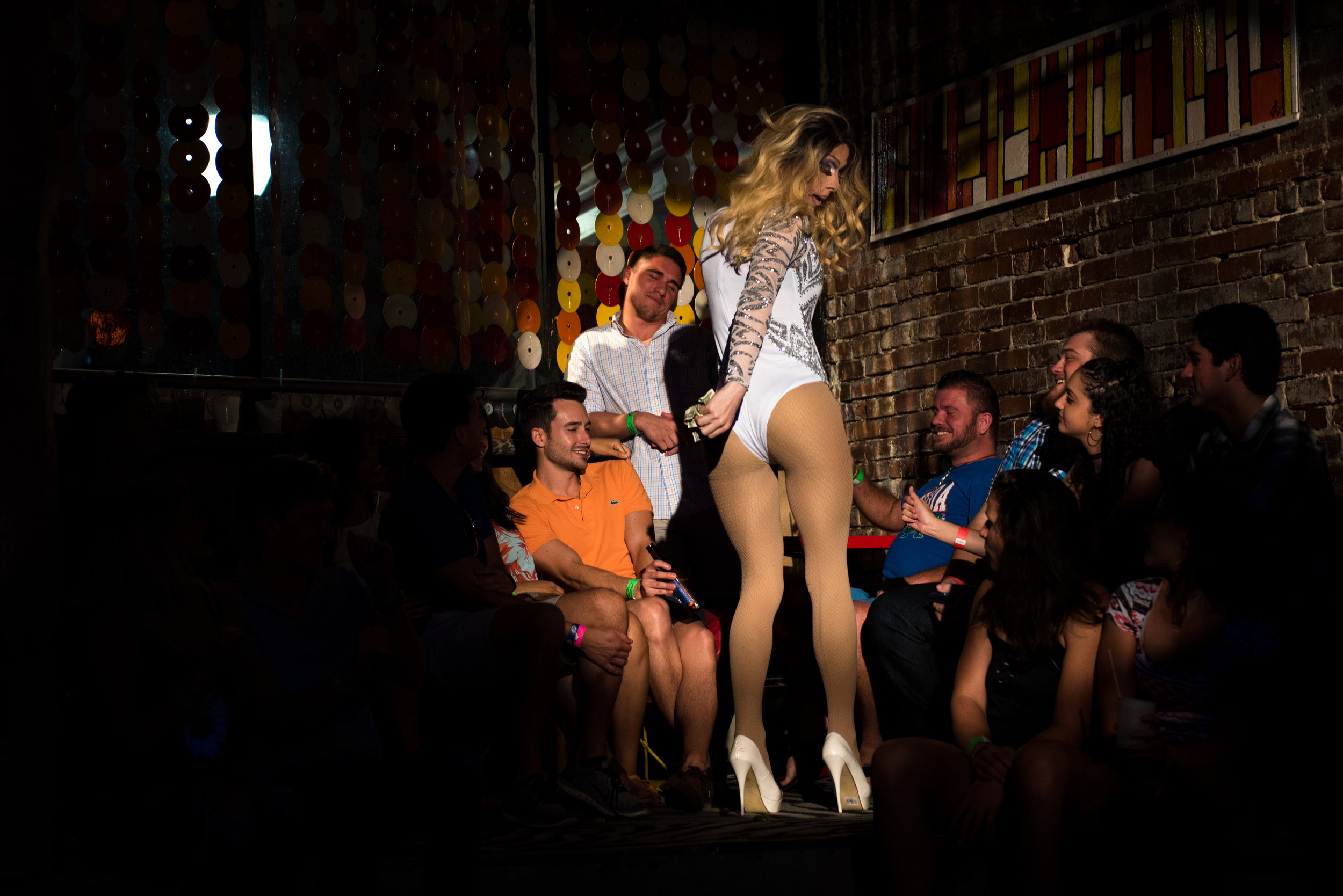 """Lip syncing to Ariana Grande's """"Side To Side,"""" Rachel makes her rounds through the crowd at a local gay club. She said she tries to involve the crowd as much as possible, pulling people to join her on stage or singling someone out to receive a lap dance."""