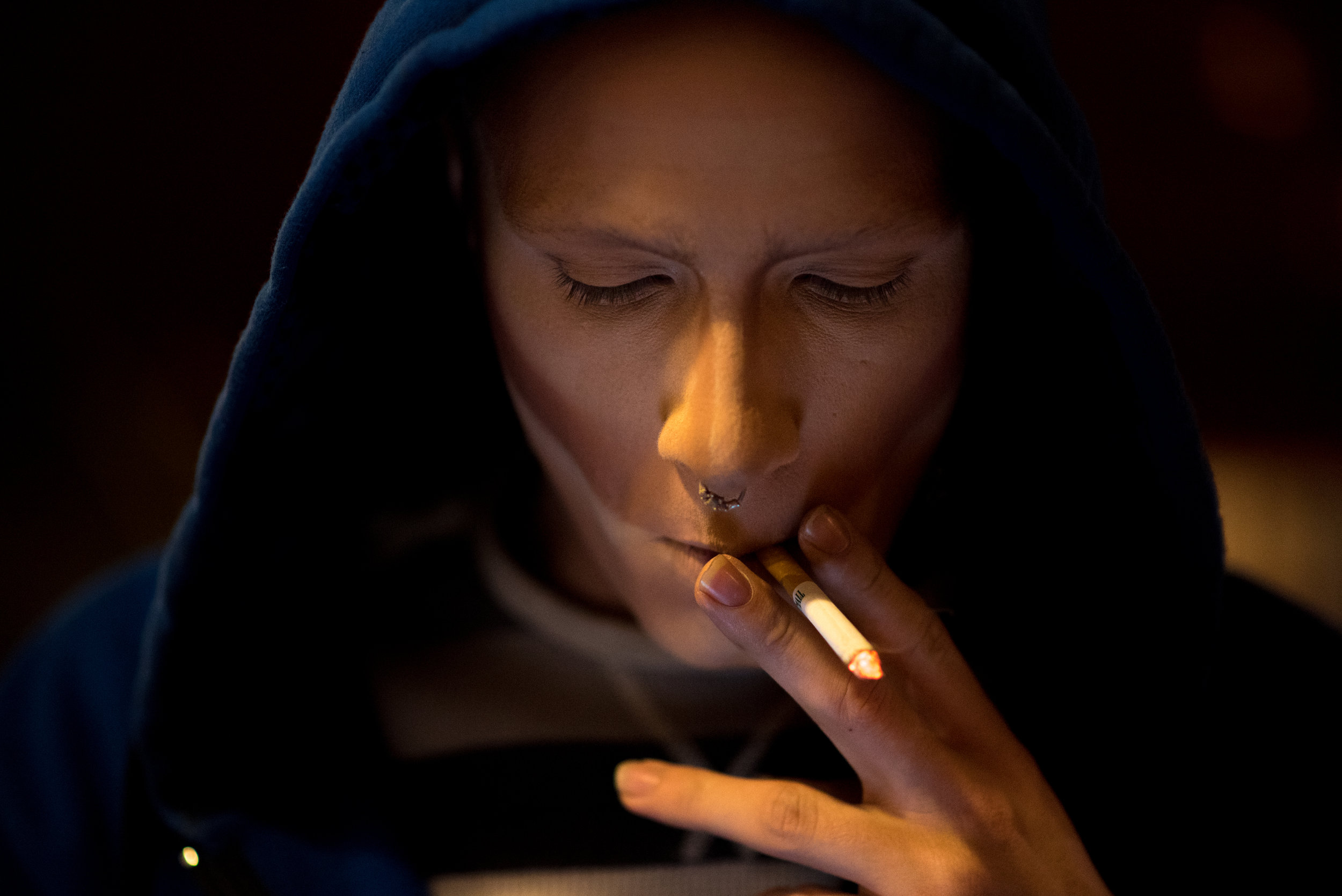 """Halfway through his makeup routine, Koedam steps outside of the dressing room to smoke a cigarette. While getting ready at most venues, he wears a blue sweatshirt with the crest of Ravenclaw from the """"Harry Potter"""" book series."""