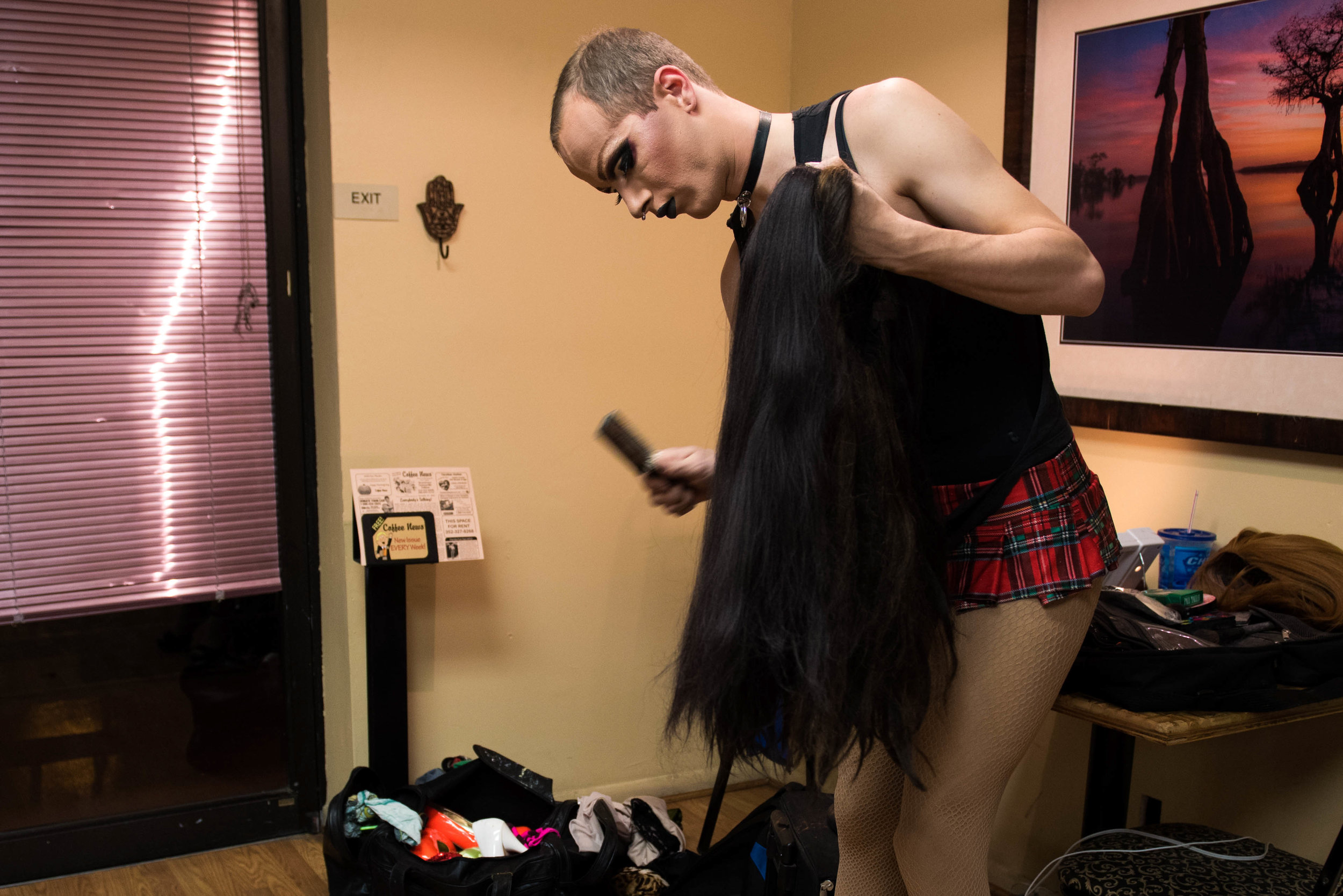 """Koedam brushes out the knots in his black wig a few minutes before his performance. He said Rachel comes more alive with each step — so he puts time and care into the details. """"I love when someone looks at me as Rachel and doesn't believe I'm a boy,"""" Koedam said."""
