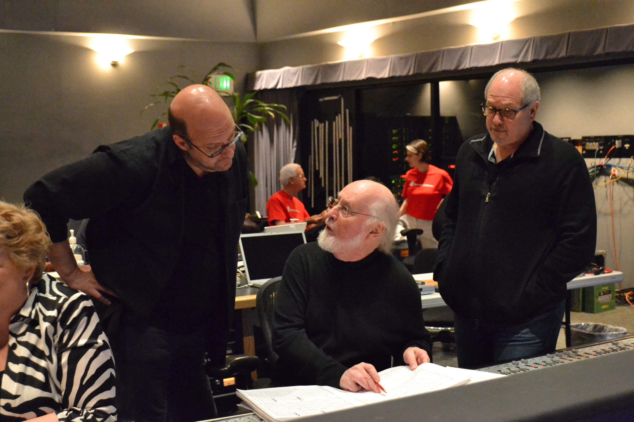 Arranger and pianist Randy Kerber discusses the score with conductor John Williams and mixer Dennis Sands.