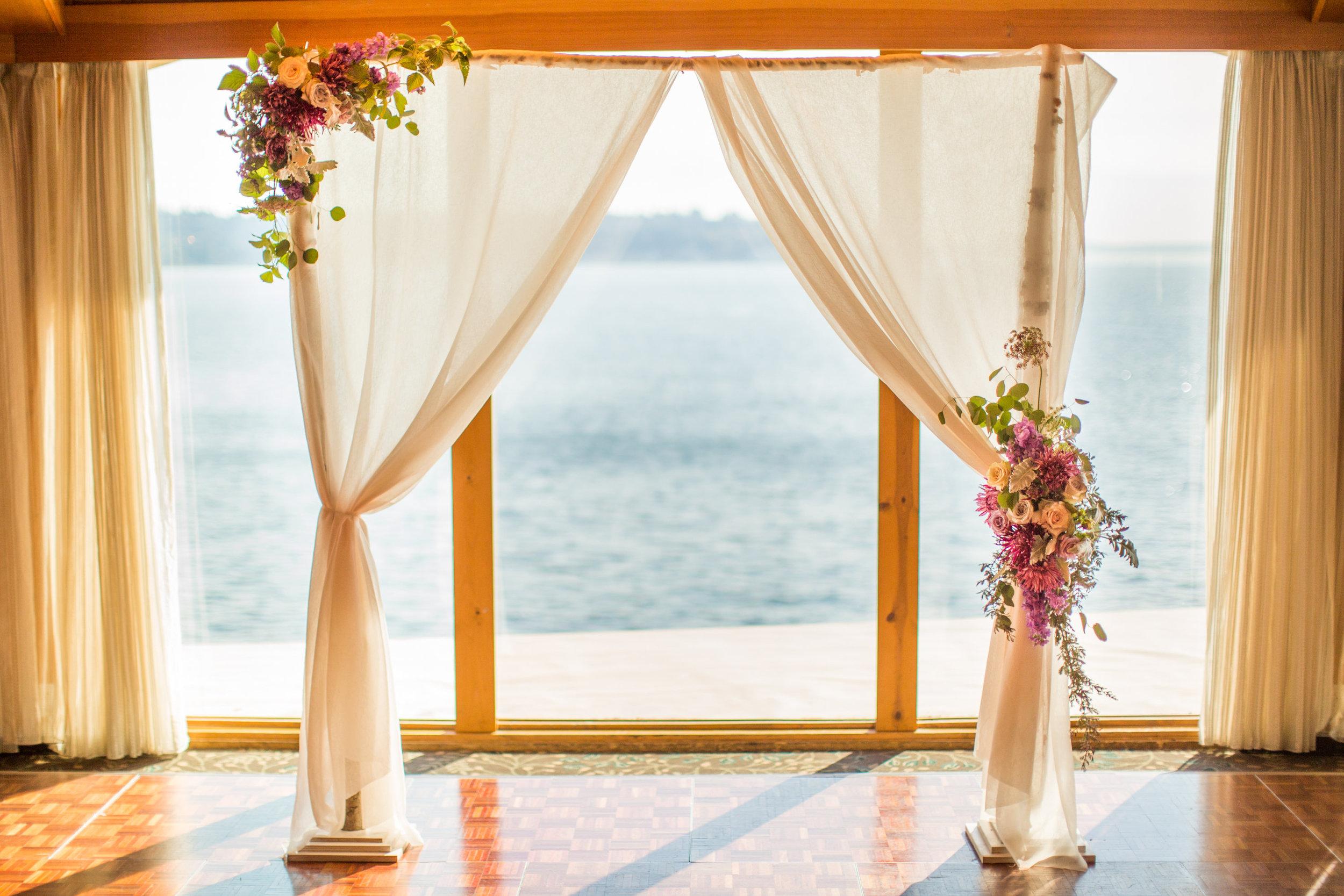 Seattle Wedding Planner, Wedding Wise | Ciccarelli Photography | Edgewater Hotel Wedding | Purple and navy blue wedding ceremony arch | Ceremony arch draping