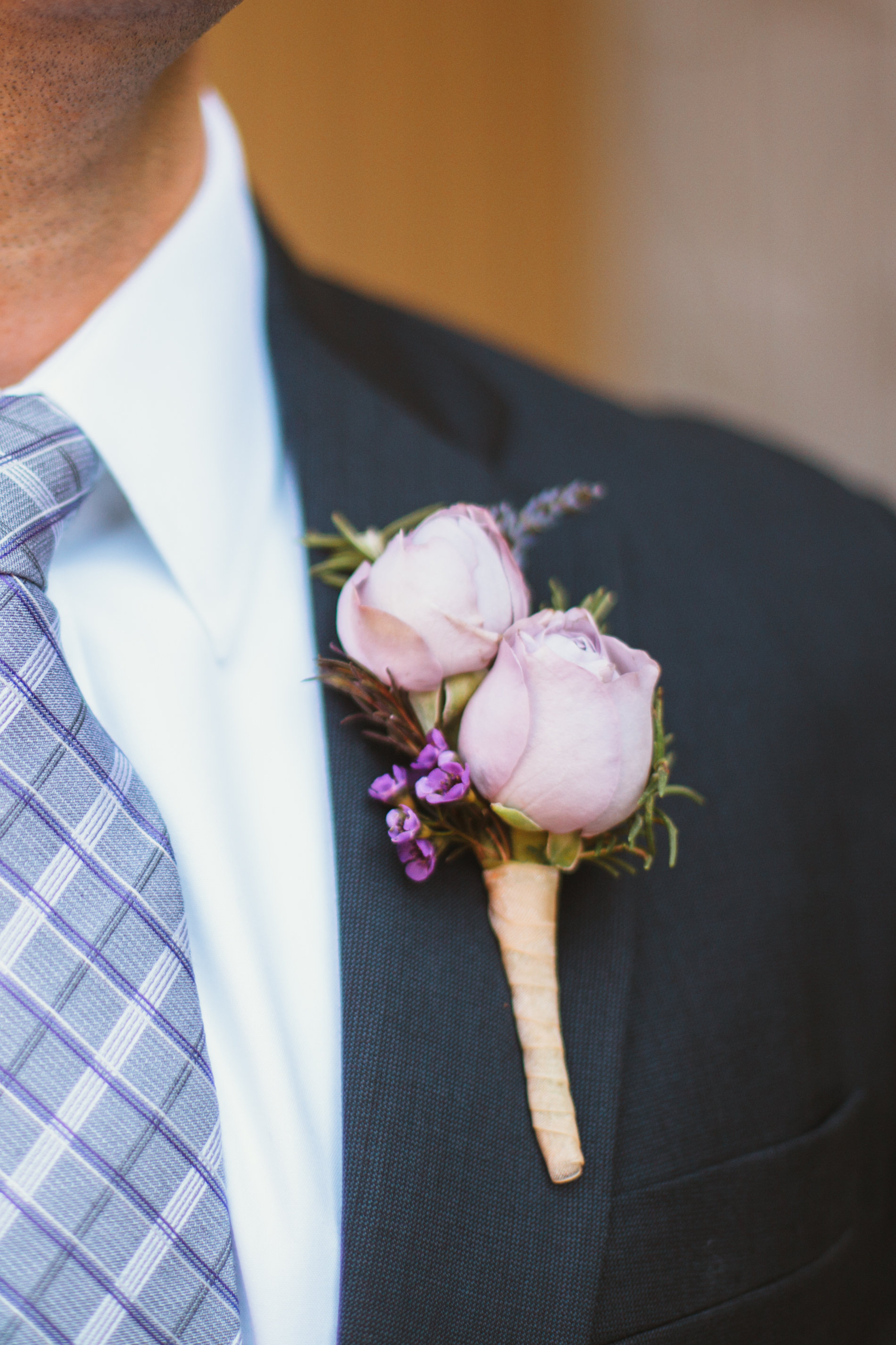 Seattle Wedding Planner, Wedding Wise | Ciccarelli Photography | Edgewater Hotel Wedding | Light purple groom's boutonniere on navy blue suit