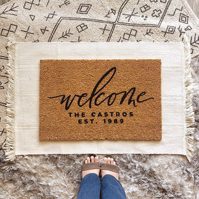 "Officially ADDED this classic style to the online shop. It's great for those who don't want their name huge and on blast. 🛍 SHOP the ""Welcome Family Year Doormat"" through the Doormat LINK IN BIO! ____ And please IF YOU HAVEN'T YET, check the ""Doormat INFO"" HIGHLIGHT for some VERY important news! #HomeMadeByTerri #customdoormats • • • • • #madebyterri #handlettering #moderncalligraphy #blocklettering #handpainted #doormat #homesweethome #newparent #closinggifts #sandiegorealestate #firsthome #homeowners #doormatsofinstagram #welcomehome #theeverygirlathome #apartmenttherapy #mydomaine #homedecor #frontporchgoals #hmhome #ikeahome #targethome #holidaygiftideas #weddinggiftidea"