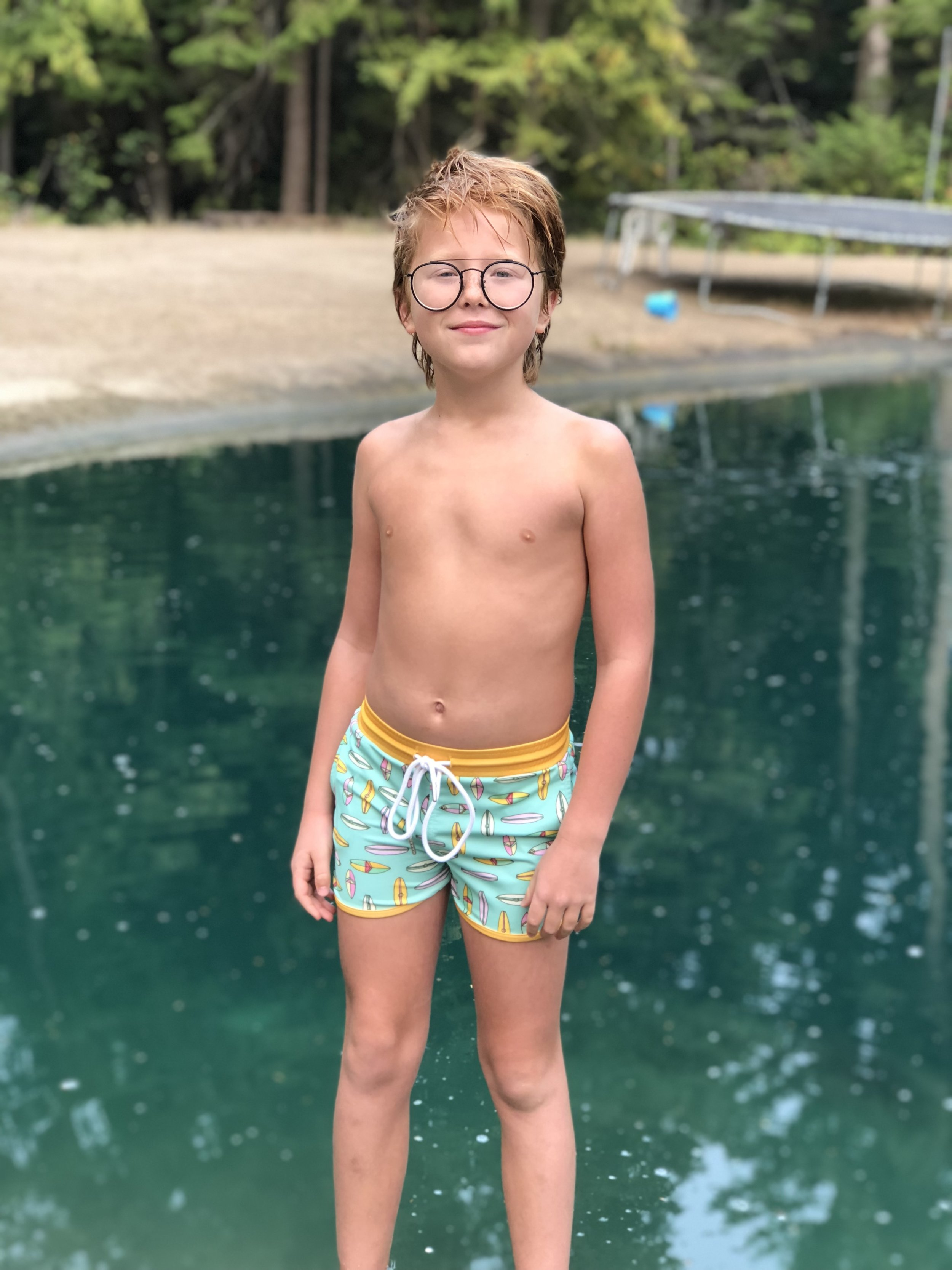 """SARA J. - USA   """"We are thrilled quality and construction of our son's Fisher Euro Board Short. He hates huge trunks and too often smaller cuts are made with flimsy fabric that wears out almost instantly. These suits are wonderful and long lasting, (which make great hand-me-downs.) Can't wait for the next line soon!"""""""