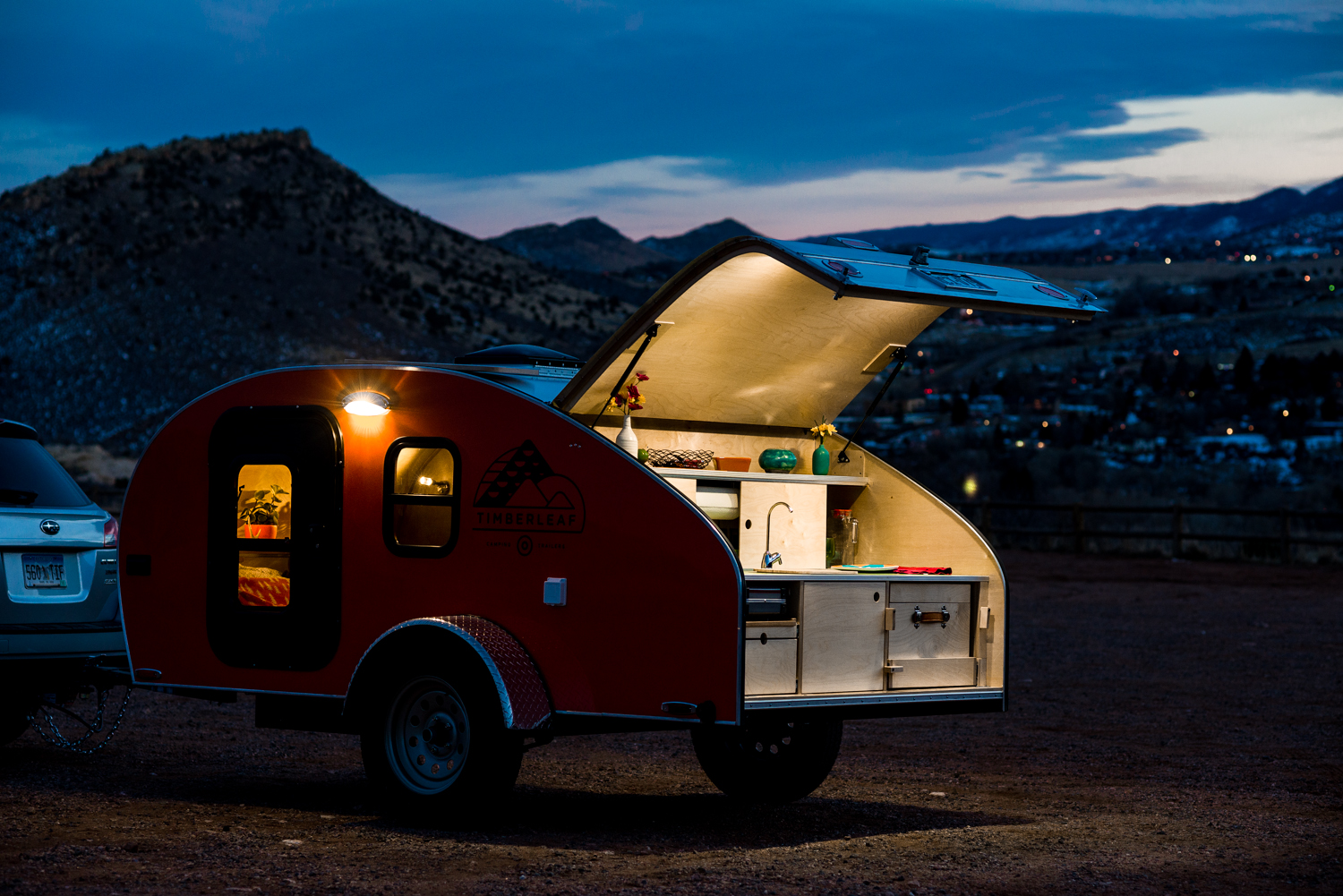 Two overhead LED lights are standard for late-night cooking in our teardrop trailer.
