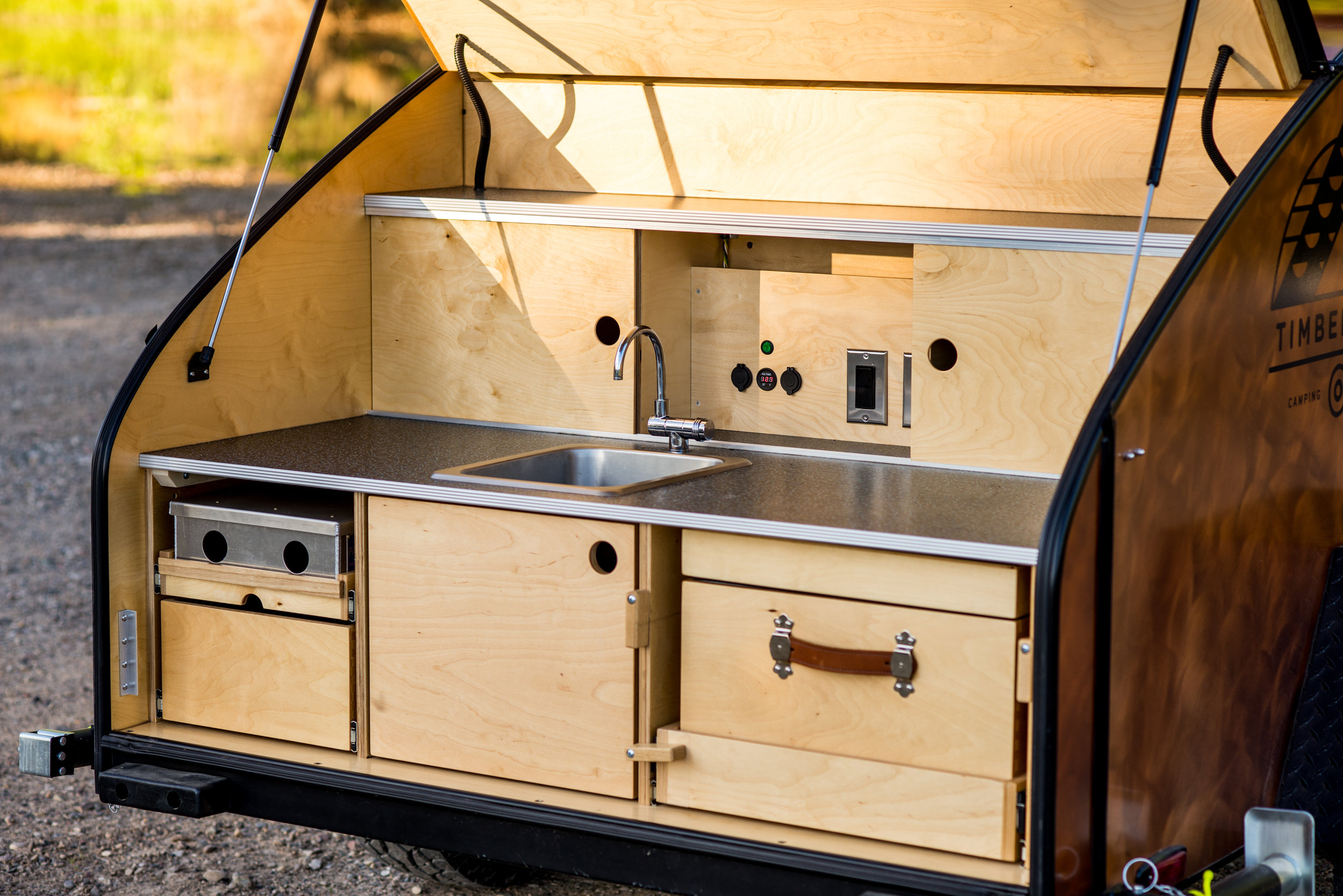 Teardrop Trailer Fully Equipped Galley, complete with sink, stove, and custom cooler.