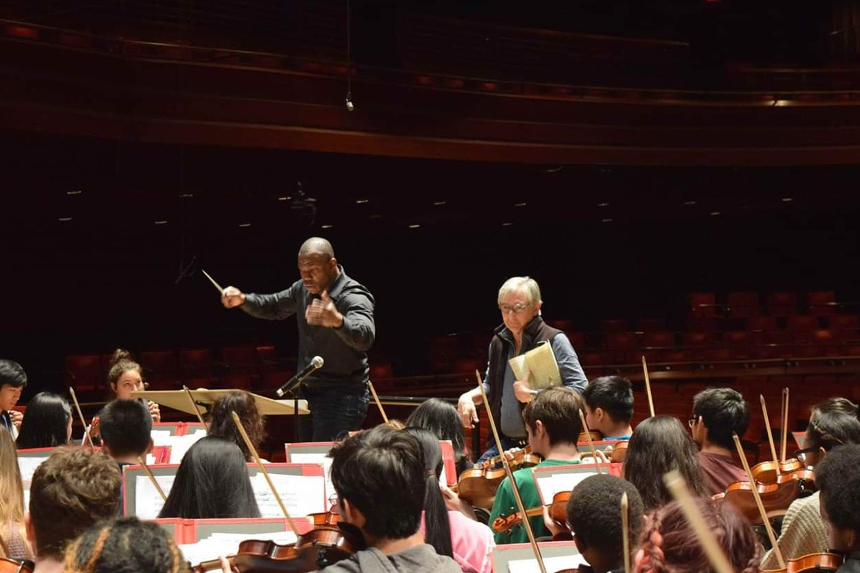 Michael Tilson Thomas working with Joseph Conyers and the All-City Orchestra.