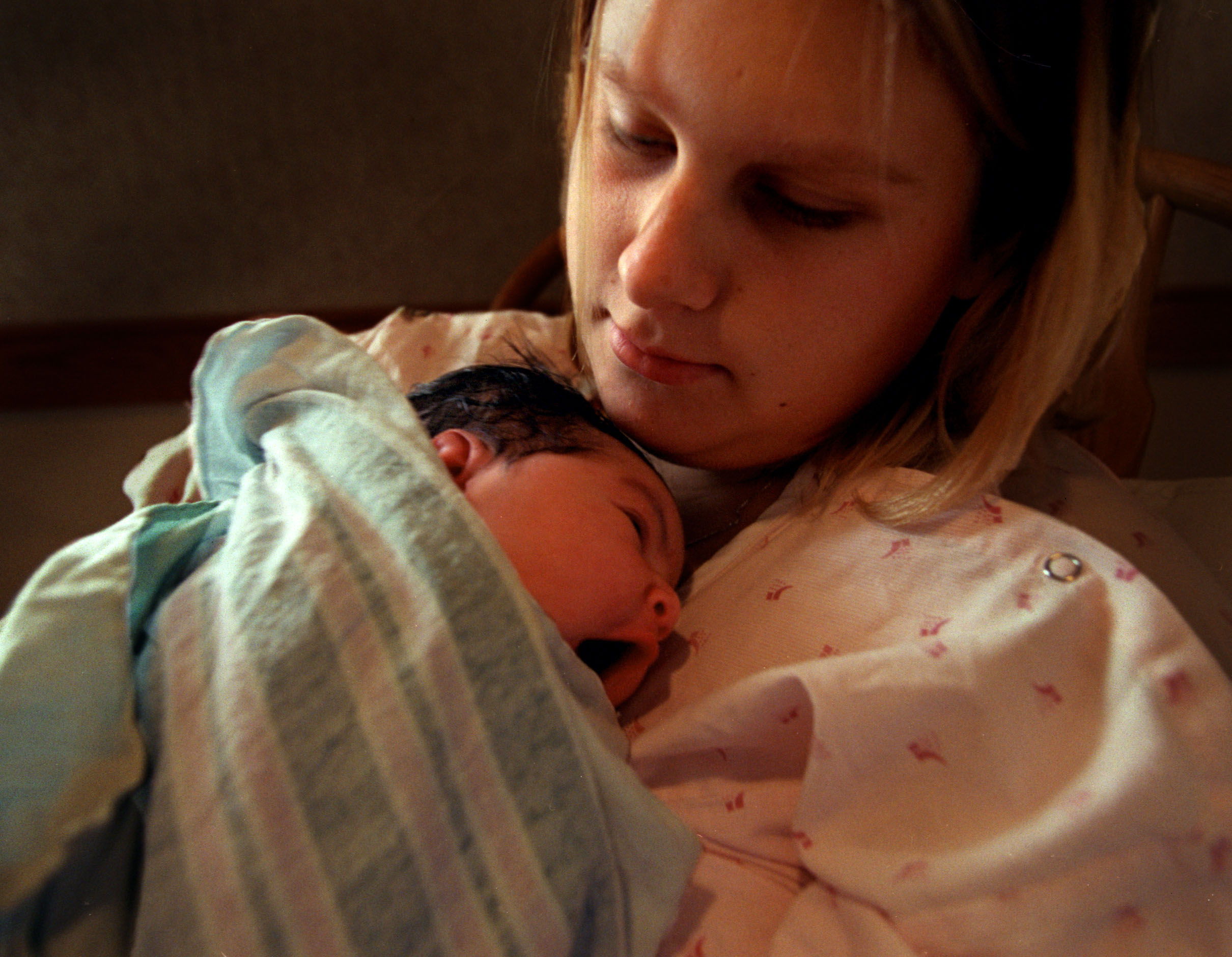 "Janea holds her newborn daughter, Leilani, shortly after giving birth. ""I've seen what happens when parents really mess up and their kids end up in foster care group home system. I don't want that for my child. I mean that's like almost damning someone to hell, "" says Janea. ©Gail Fisher Los Angeles Times"