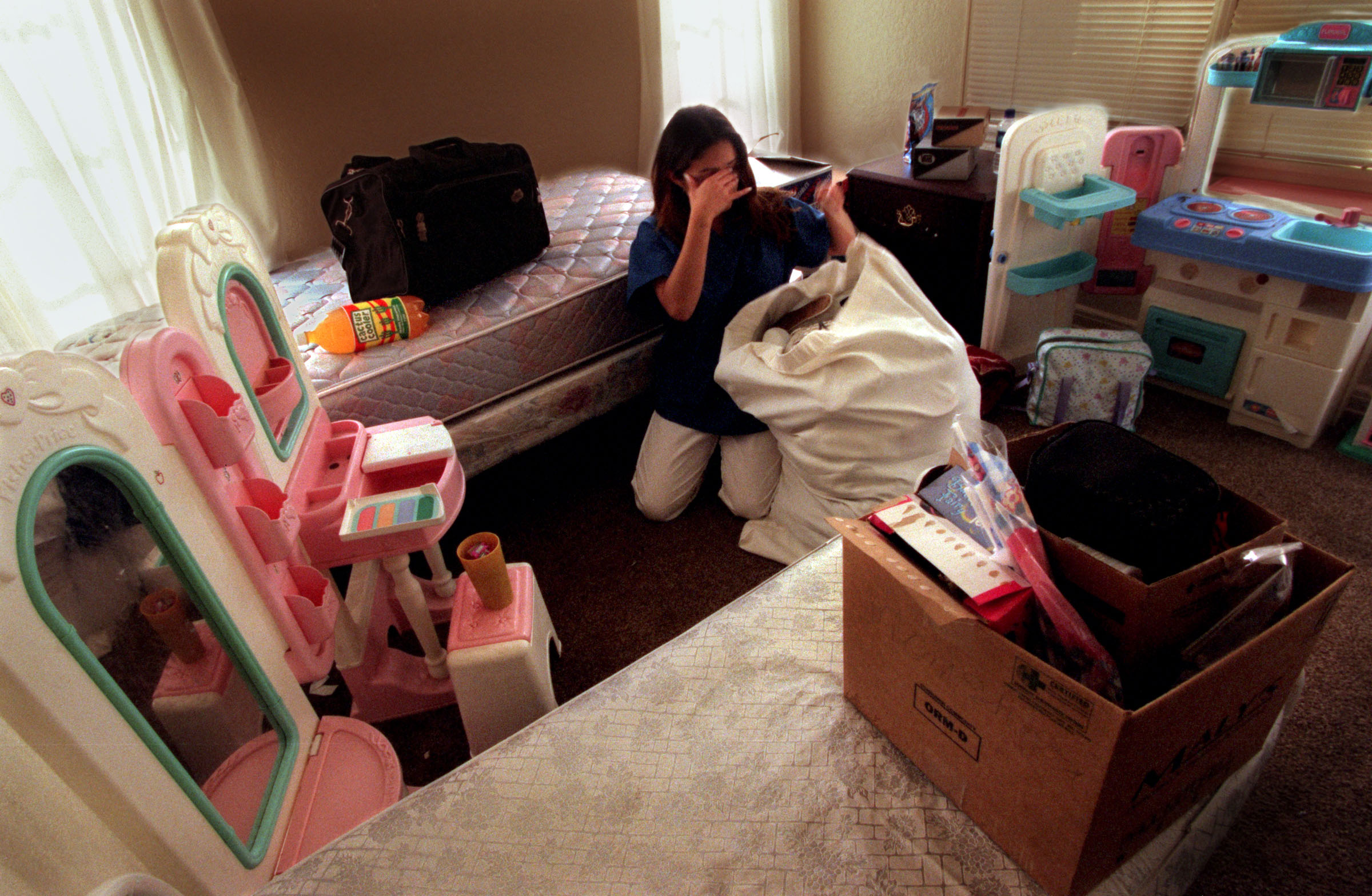 Monique packs up her belongings at Stepping Stones. She is asked to leave after getting in a fight with one of her roommates and not following the house rules. ©Gail Fisher Los Angeles Times