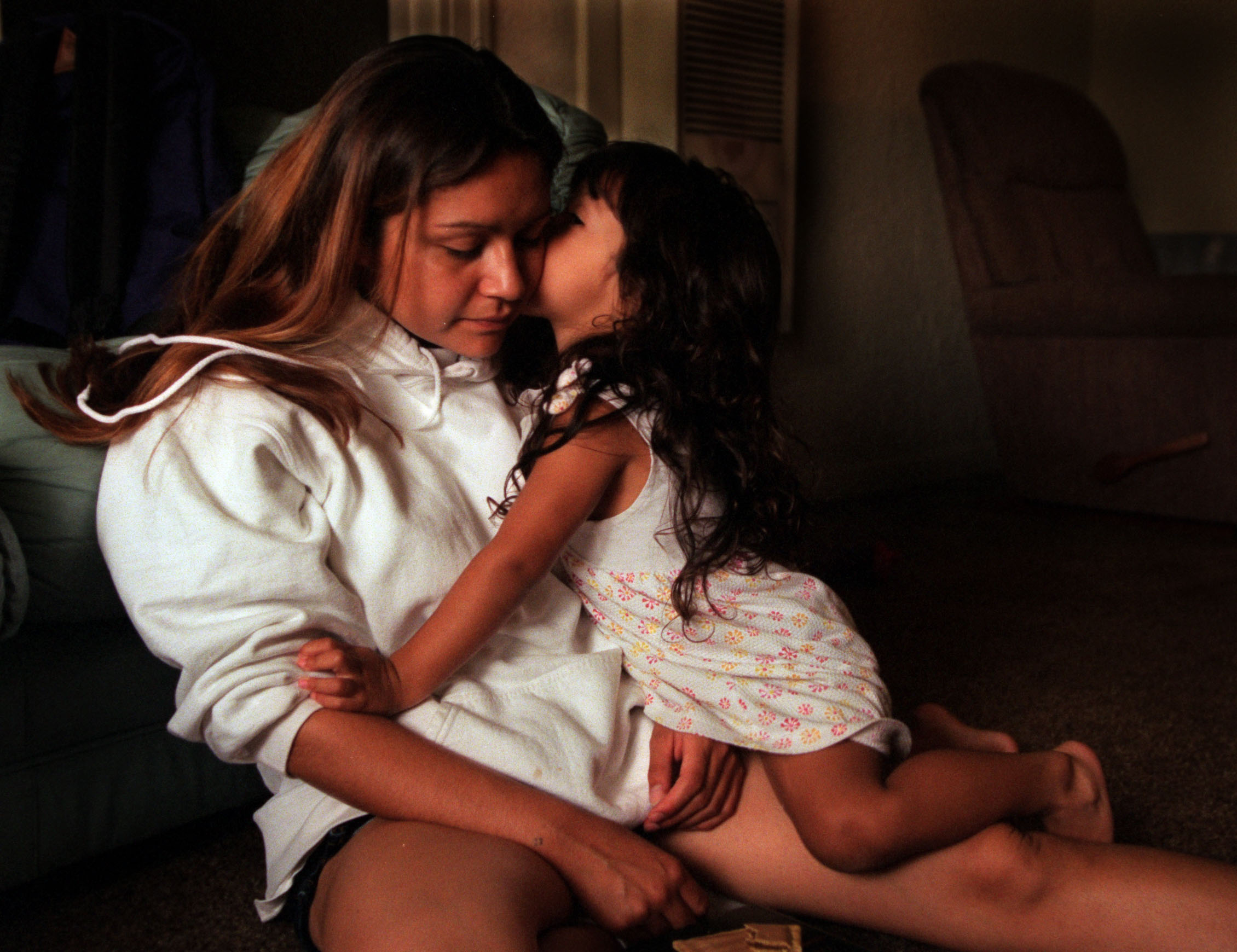 "After Monique's grandmother died, she lived on her own at the age of 15 until someone ""ratted her out"" and she was taken into custody by child protective services. Still a minor, she and Lyla became wards of the court. ©Gail Fisher Los Angeles Times"