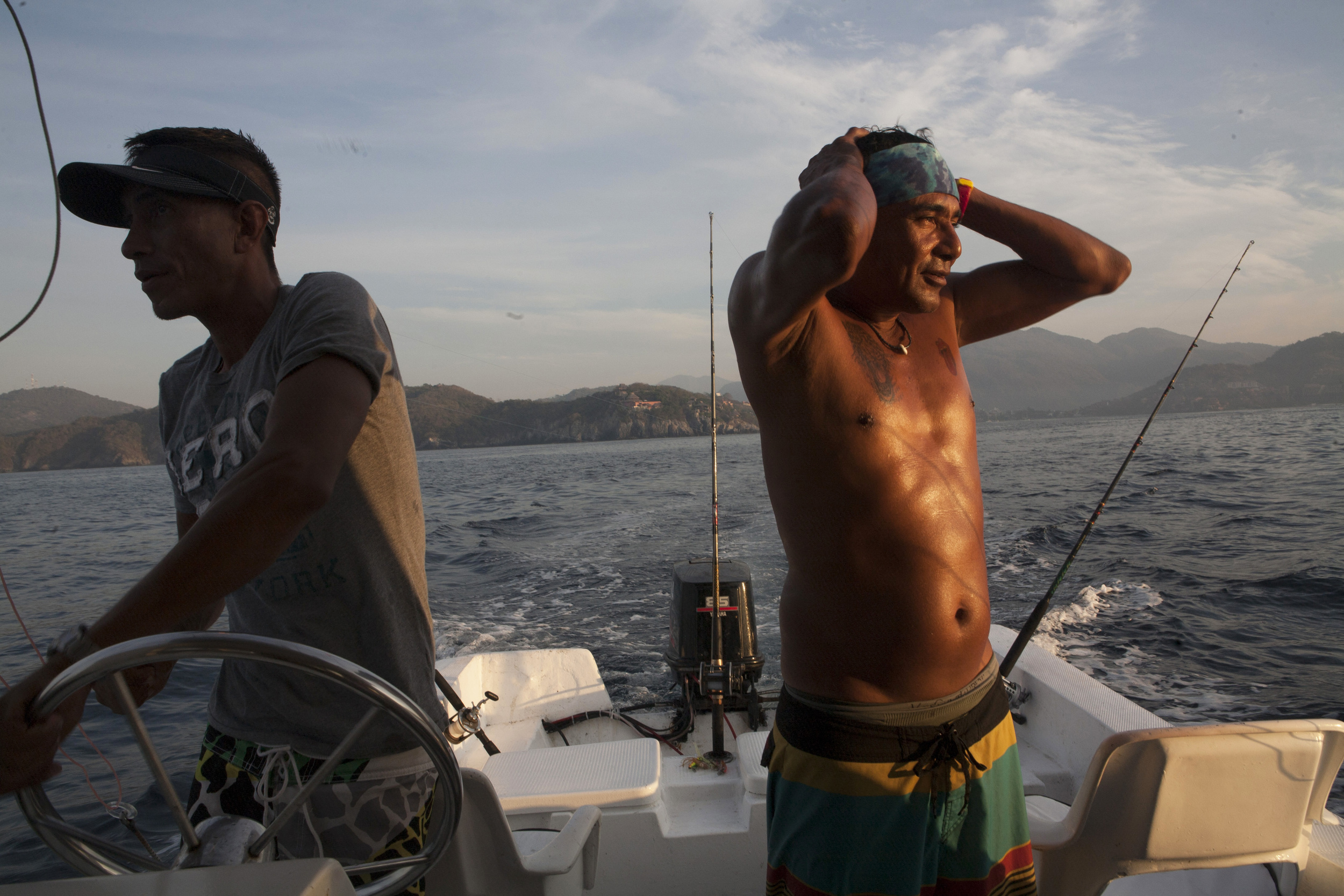 "Polo Flores, right and Gustavo Farfan, left, were our fishing and snorkeling guides aboard the ""Reny,"" where we spent the day enjoying the the Zihuatanejo Bay from a different perspective. ©Gail Fisher"