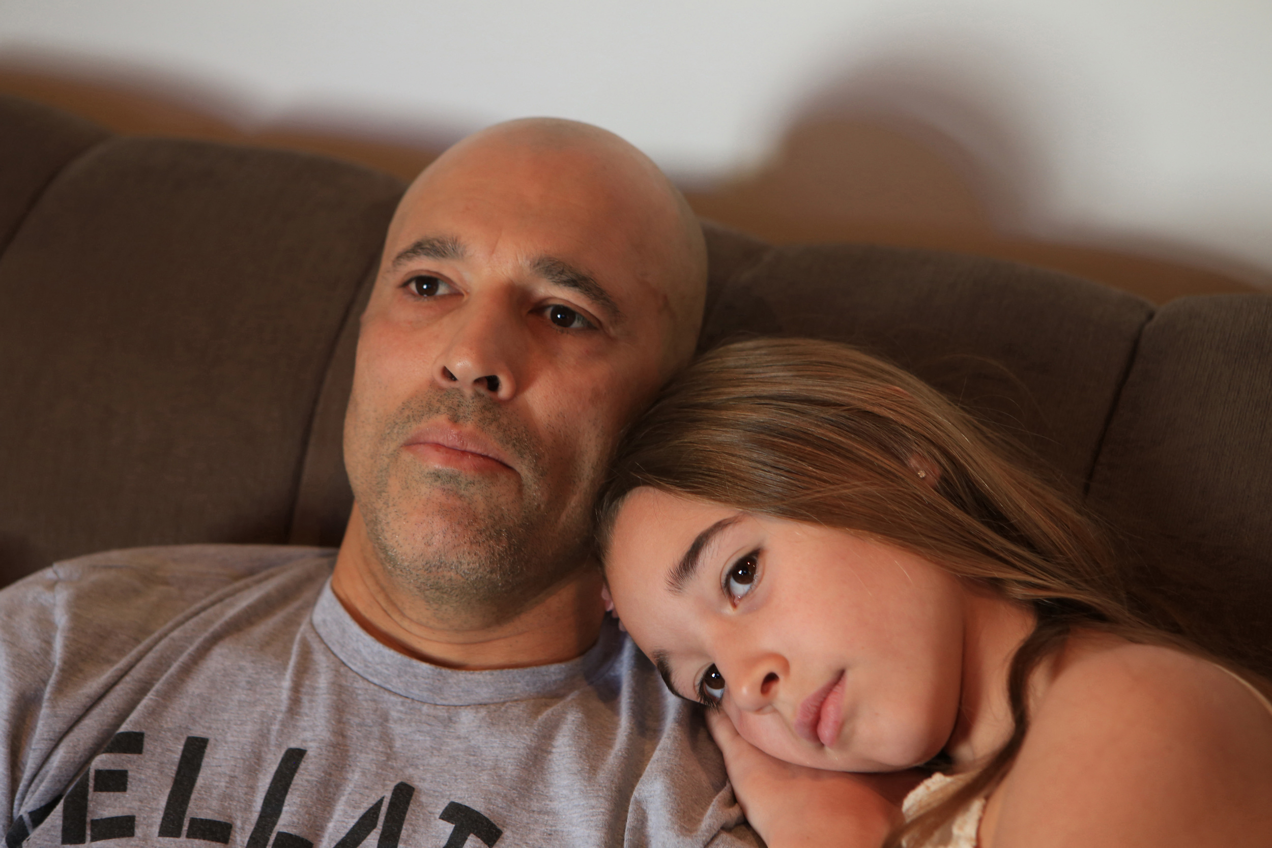 Royce Gracie, father and professional mixed martial artist for Bellator MMA, left, watches early morning television with his 10-year-old daughter, Kharianna, right, after packing her lunch, fixing her breakfast and before taking her to school at their home in Palos Verdes Estates, CA. (©Gail Fisher for ESPN)
