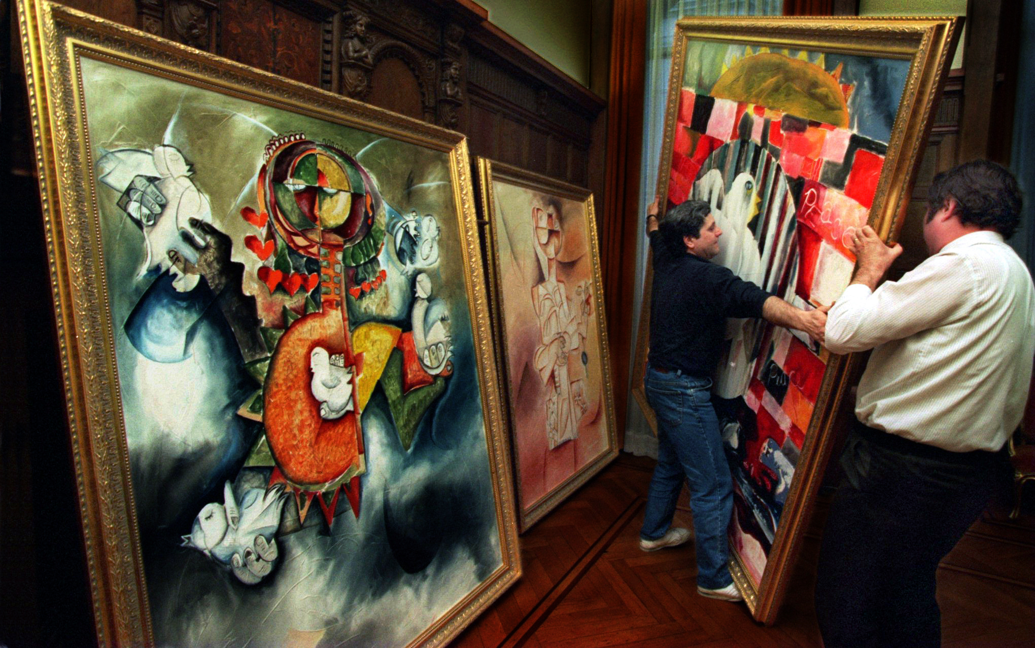 Alexandra Nechita's paintings were recovered from customs and displayed in the Romanian Embassy barely in time for media and dignitaries to view during a reception held on the last evening of their tour in London. ©Gail Fisher Los Angeles Times
