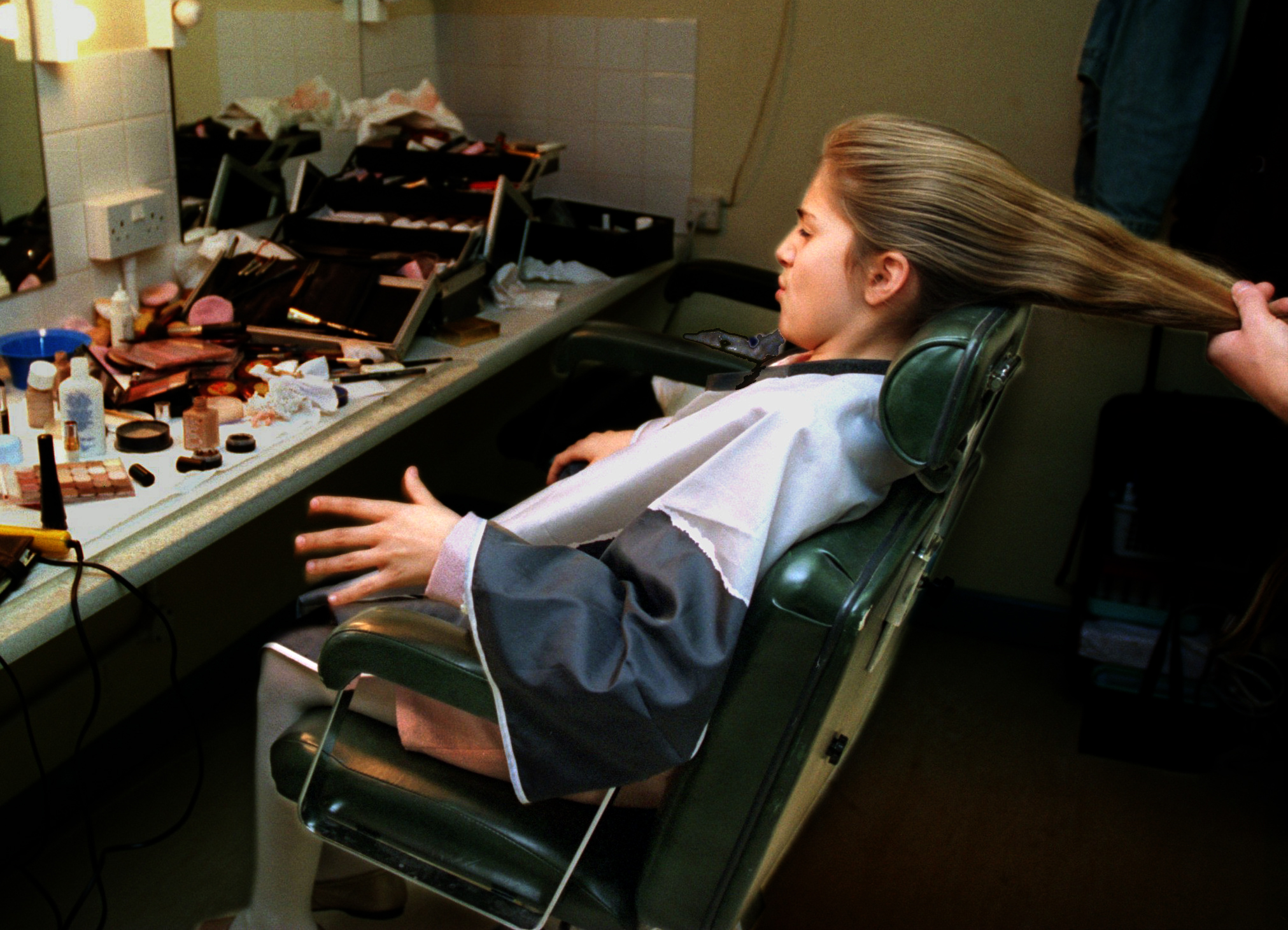 """Alexandra Nechita, 10, has a touch-up done on her hair before going on television show """"ESTER,"""" a London version of Oprah. This was part of her seven-nation European tour in March, in which she was accorded a constant stream of media attention. ©Gail Fisher Los Angeles Times"""