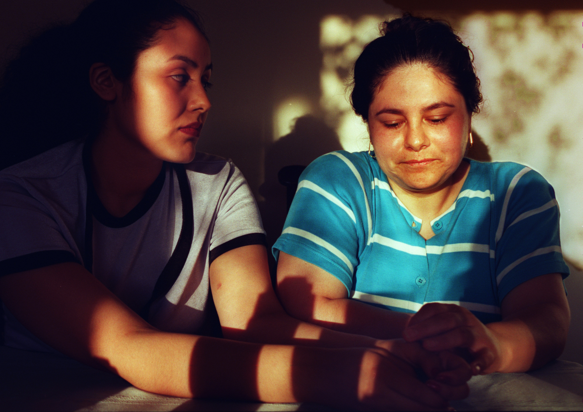 Araceli with her mother, Lupe Almaguer, worries her mother works too hard. Lupe supports the family of five on the $400 to $500 she earns each week cleaning houses in Irvine, Tustin and Newport Beach. Most weeks, she works all seven days. ©Gail Fisher Los Angeles Times