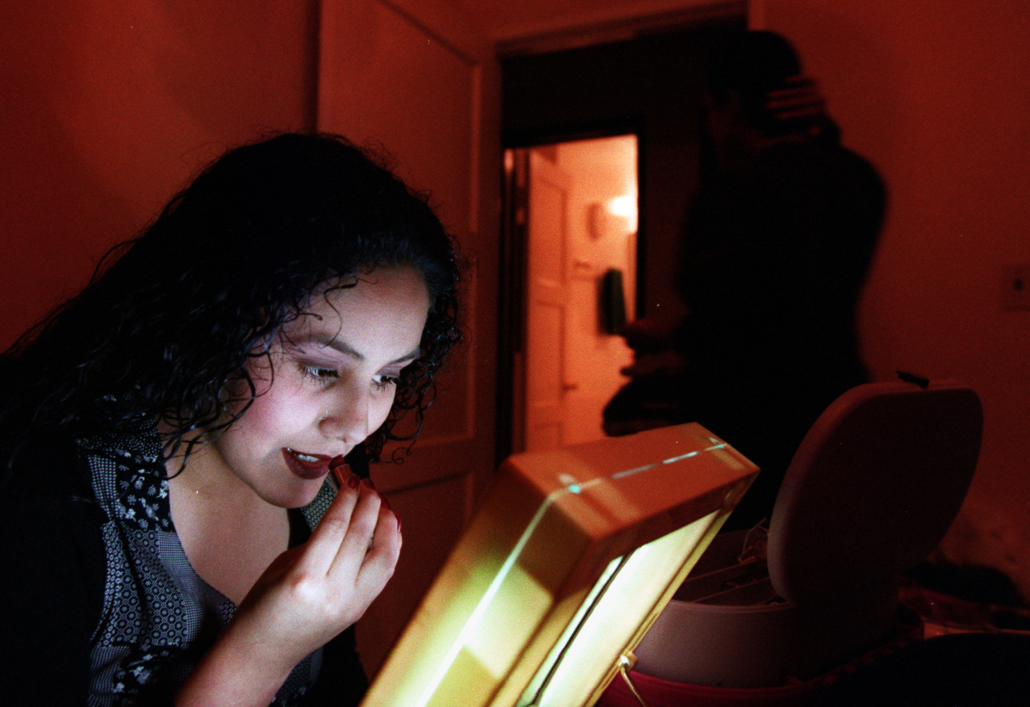 Listening to '60s music on the stereo,  Araceli Almaguer,  17, prepares to go out with friendson a recent Saturday night.  ©Gail Fisher Los Angeles Times