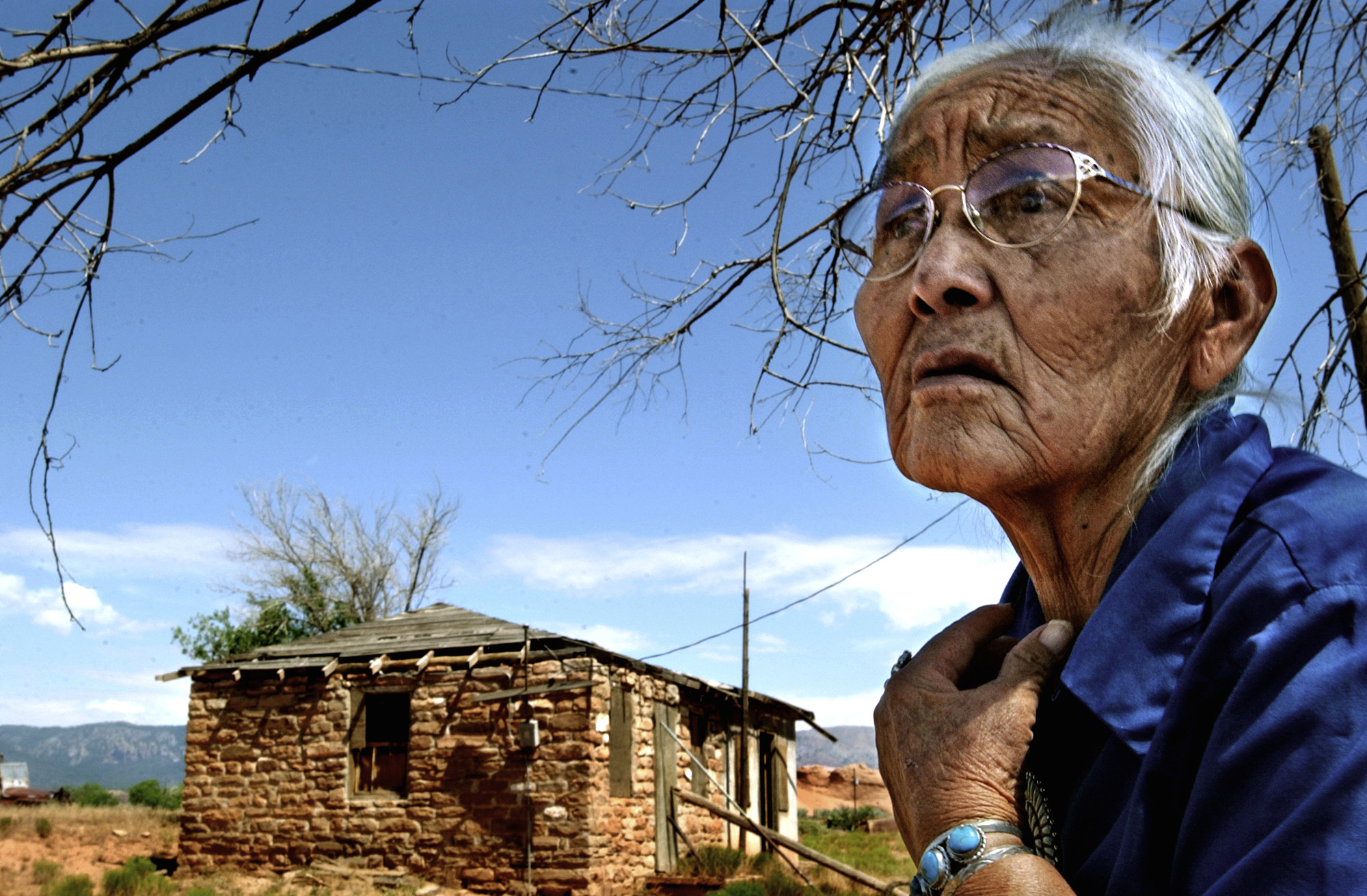 Mary Frank lost her husband Clifford to lung cancer, and then shortly afterwards, she losther home. In 1981, tribal contractors conducting environmental assessments in Oak Springs condemned 17 houses contaminated with mine uranium waste. ©Gail Fisher Los Angeles Times