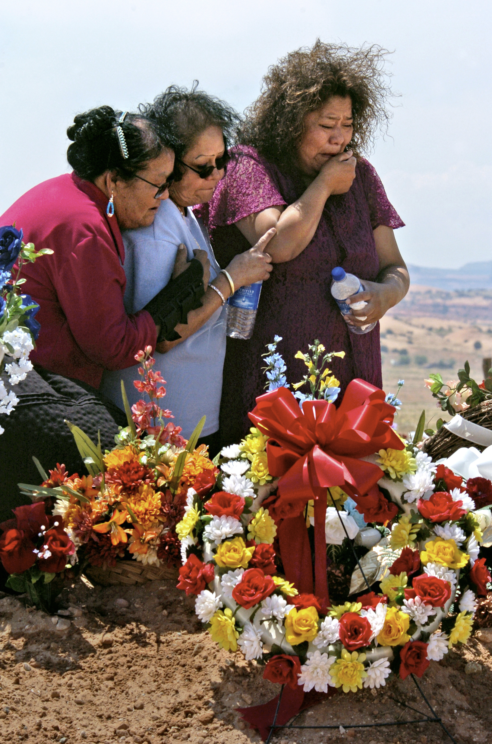 Family members grieve the death of Emerson Litson, a former uranium miner. Their angry widows wonder if they and their children face health risks fromthe abandoned mills and mines. ©Gail Fisher Los Angeles Times
