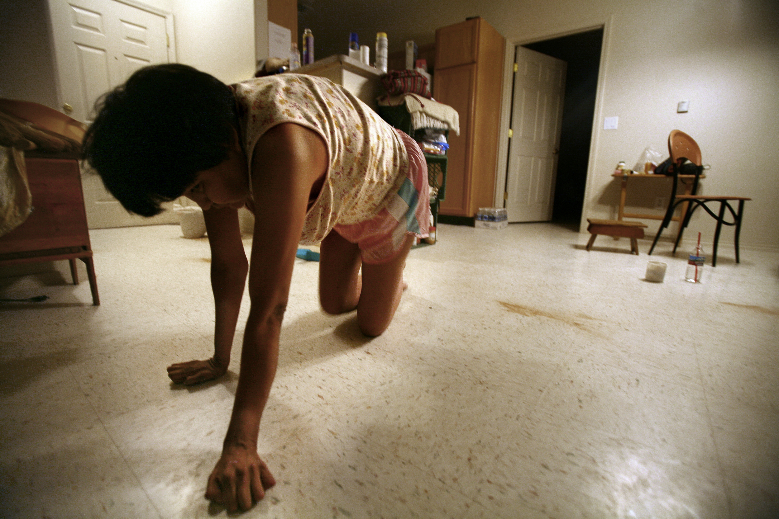 Laura Neztsosie, 36, is the oldest living person on the Indian Health Service's Navajo neuropathy registry. As the illness progresses, she loses more abilities. Her mother drank water contaminated by uranium when she was pregnant with Laura. ©Gail Fisher Los Angeles Times