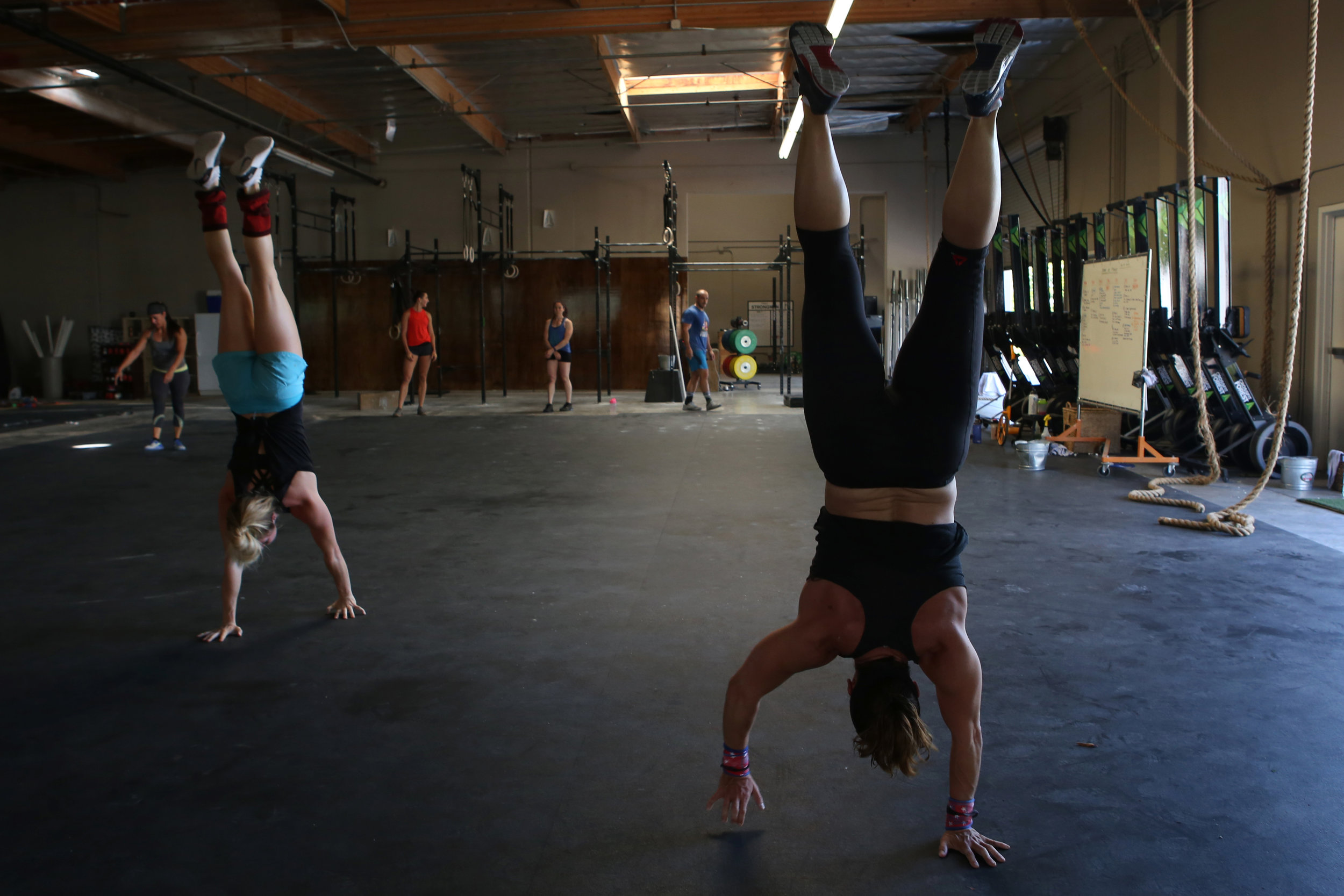 "Handstand walks are one of the CrossFit elements that uses Osborne's gymnastics skills. She competed as an elite gymnast until the grind became too much. ""As I got older, injuries and fear factor kind of deterred me from wanting to [compete] any further."" © Gail Fisher for ESPN"