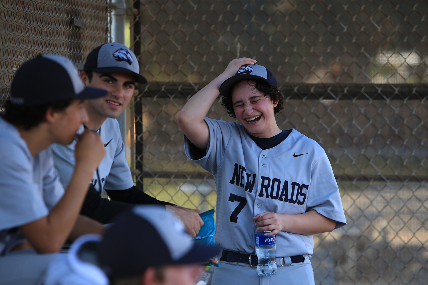 Jake Hofheimer, right, 17-year-old transgender male plays second baseman and outfielder on the New Roads Jaguars baseball team,jokes around with friend, Jake Boyle, center. © Gail Fisher for ESPN