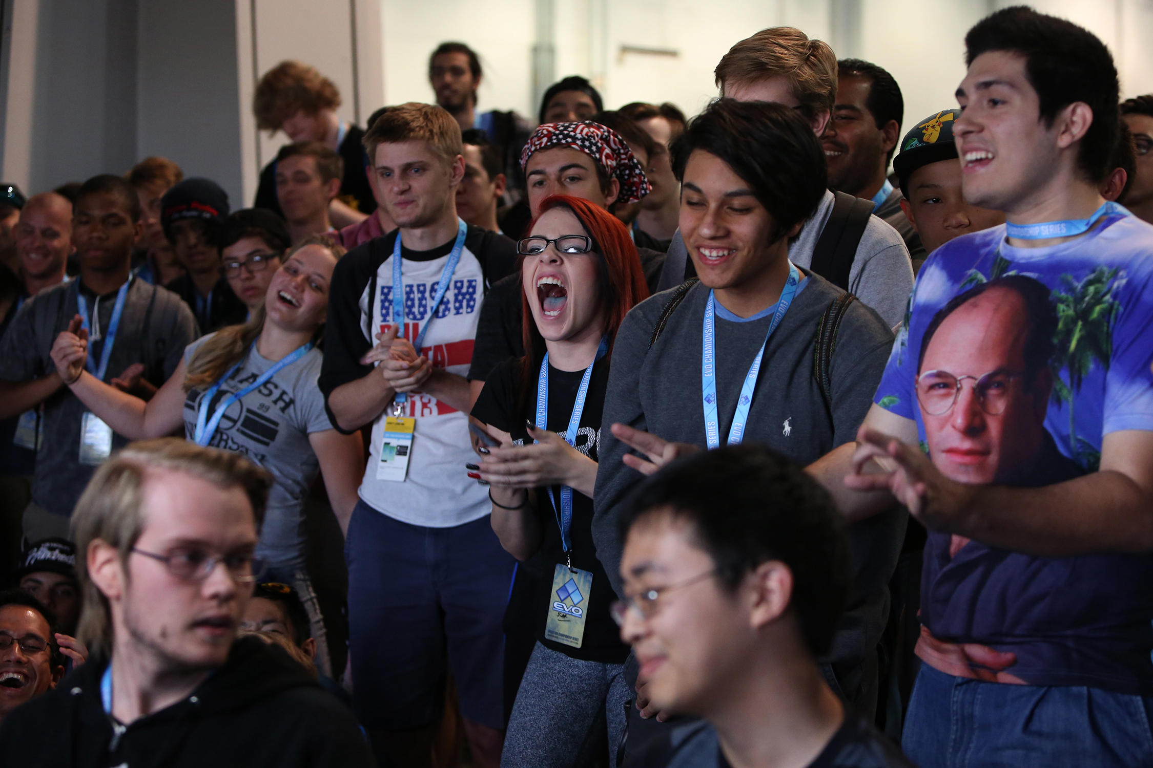 "The fans cheer Adam ""Aramada"" Lindgren, left, as he wins the Smash Bros. Melee tournament and advances to the finals.  © Gail Fisher for ESPN"