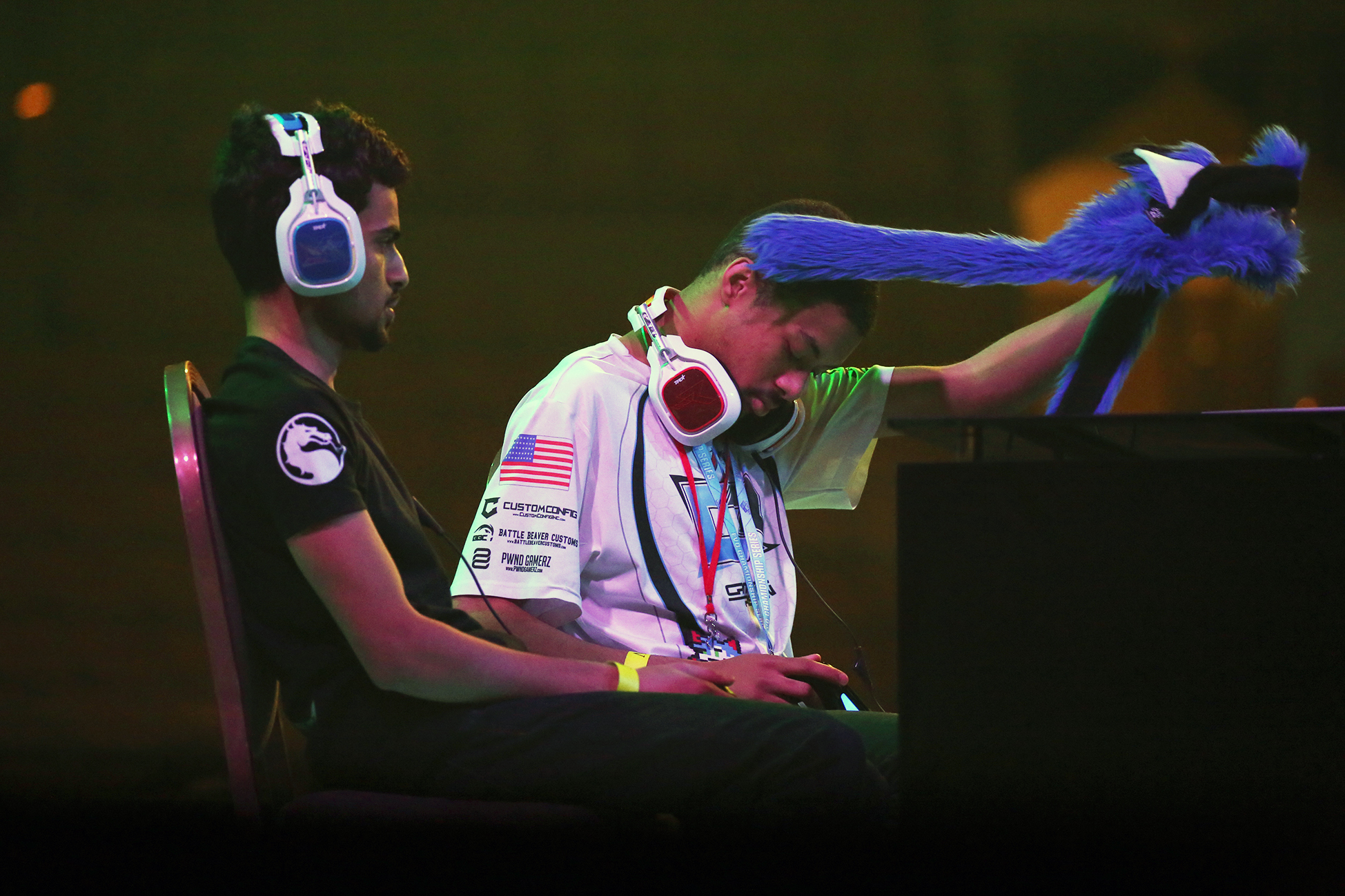"Dominic ""Sonic Fox"" McLean takes off his head covering as the heat turns up as he plays Sayed ""Tekken Master"" Hashim Ahmend. © Gail Fisher for ESPN"