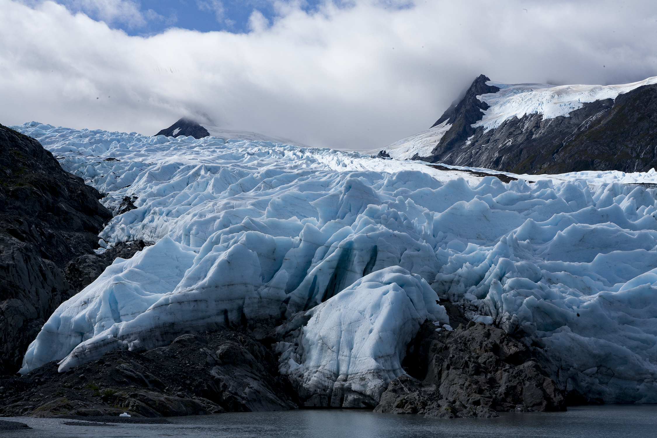 Portage Glacier has advanced and retreated over the years, due to climatic fluctuations. Moraines or large piles of rock and debris are deposited by glaciers as they flow down, or retreat from valleys. © Photo by Gail Fisher