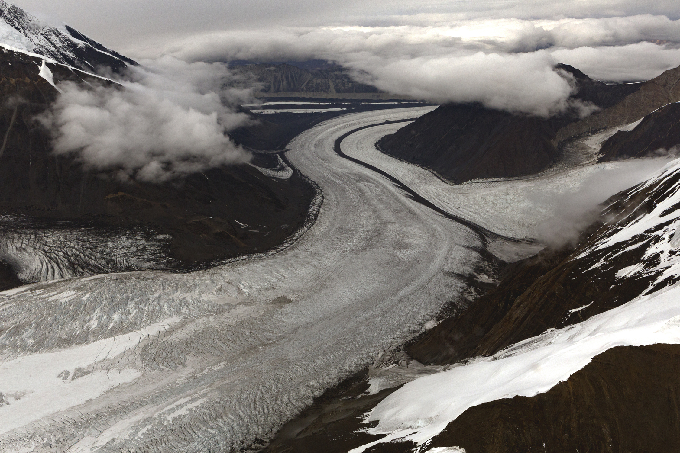Ruth Glacier and medial moraines, dark stripes of rock debris flowing down the middle. © Photo by Gail Fisher