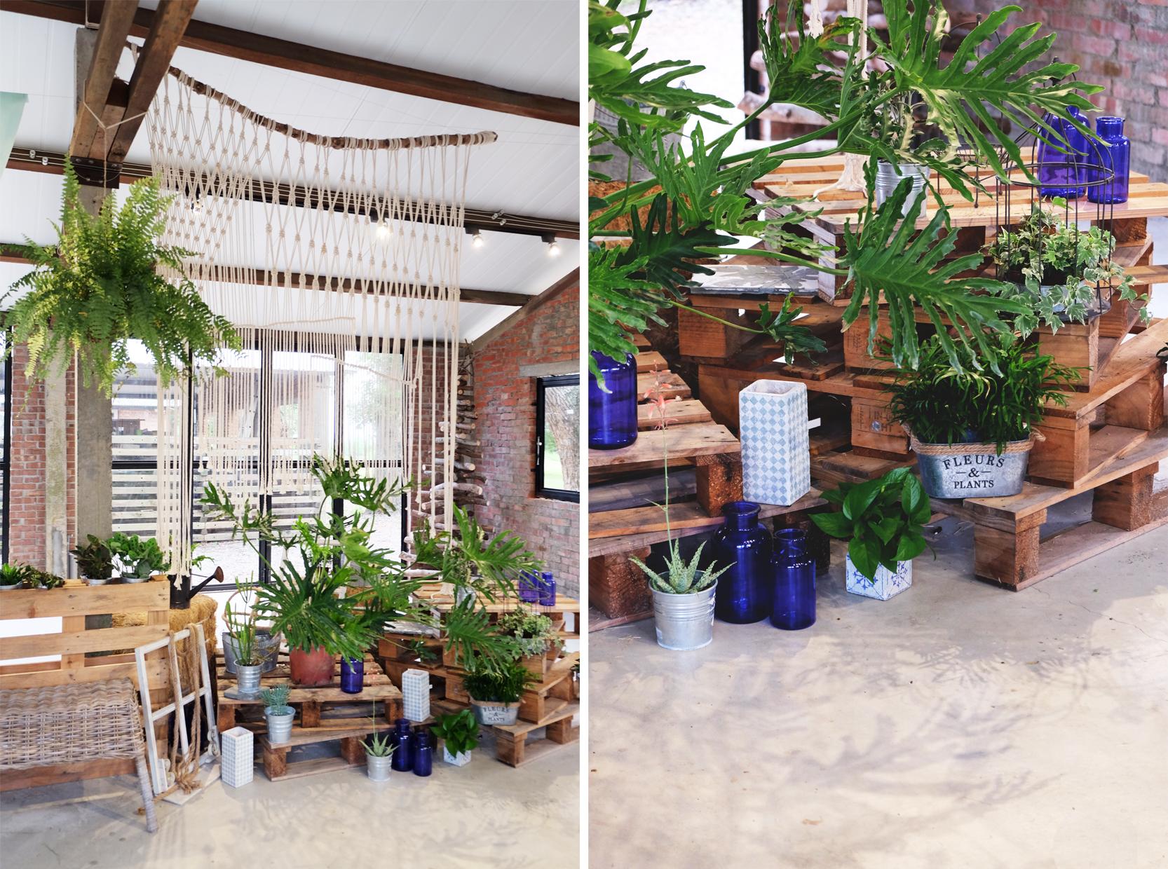 打造一區利用棧板堆疊起的角落, 在注入滿滿植栽和編織流蘇後,為臥室自然而然形成了一道隔間。