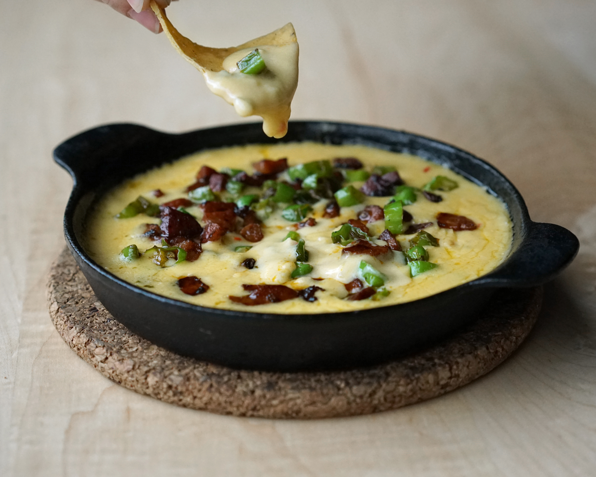 Chorizo Queso Fundido  The Chorizo Queso Fundido was so popular for Cinco de Mayo that we decided to officially add it to our menu. Order it with a side of chips and tequila for the perfect snack.
