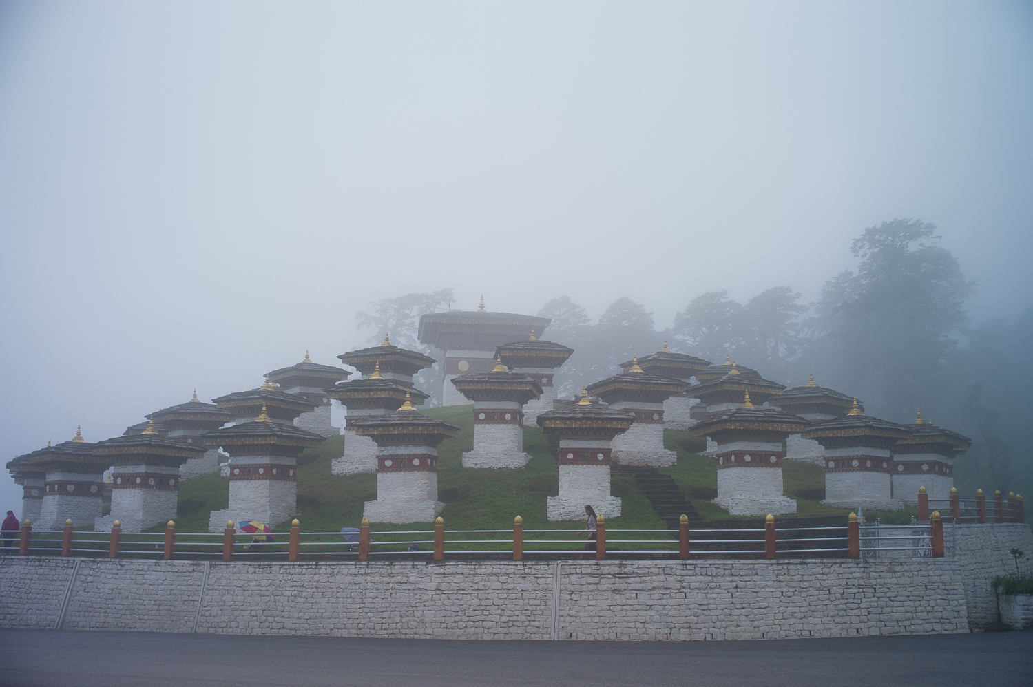 It gets really foggy around the midway to Punakha, note that people are walking around these pagodas numerous times as if they recite mantra numerous times